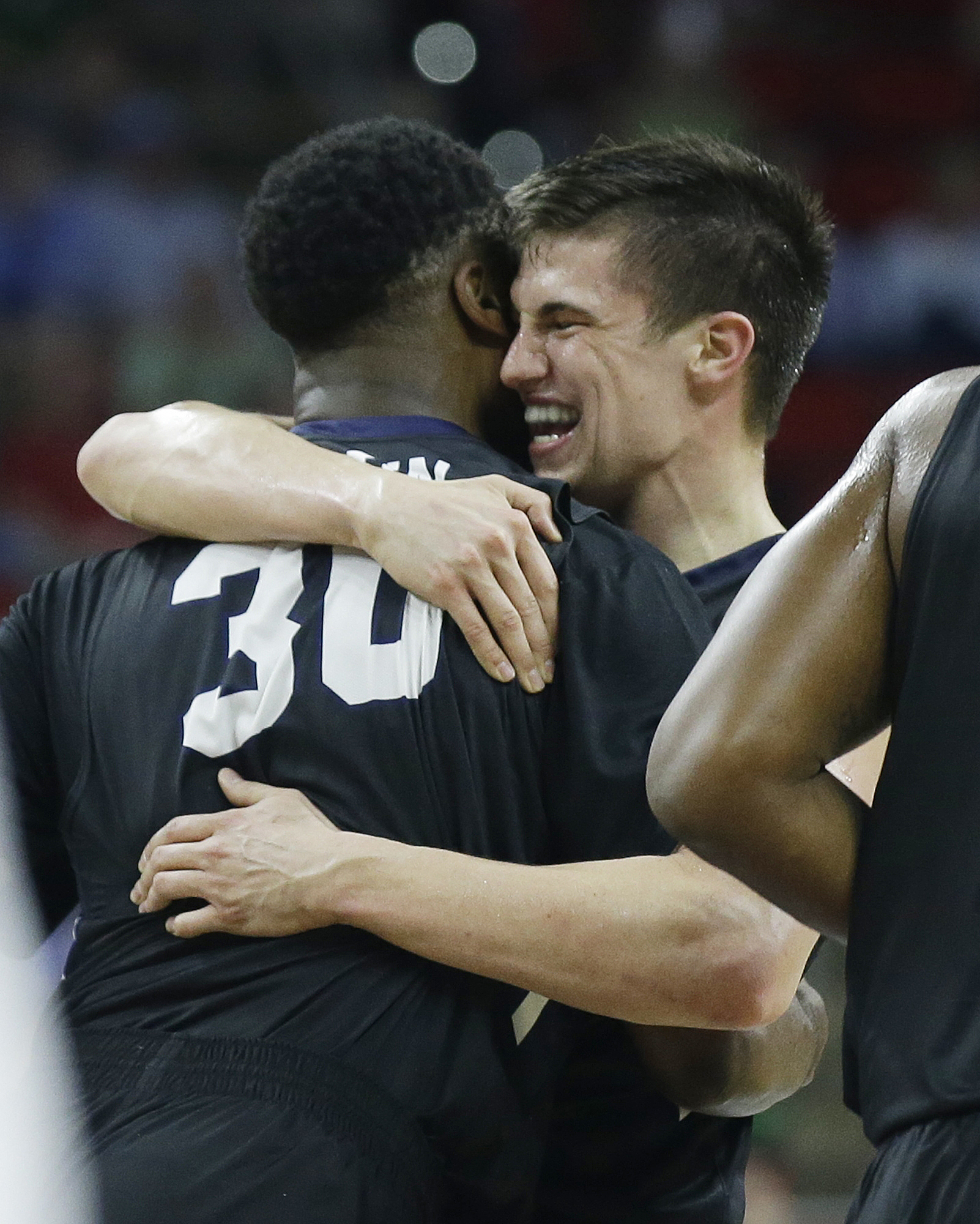 Butler guard Kellen Dunham (24) celebrates with Butler forward Kelan Martin (30) after the second half of a first-round men's college basketball game in the NCAA Tournament against Texas Tech, Thursday, March 17, 2016, in Raleigh, N.C. Butler won 71-61. (