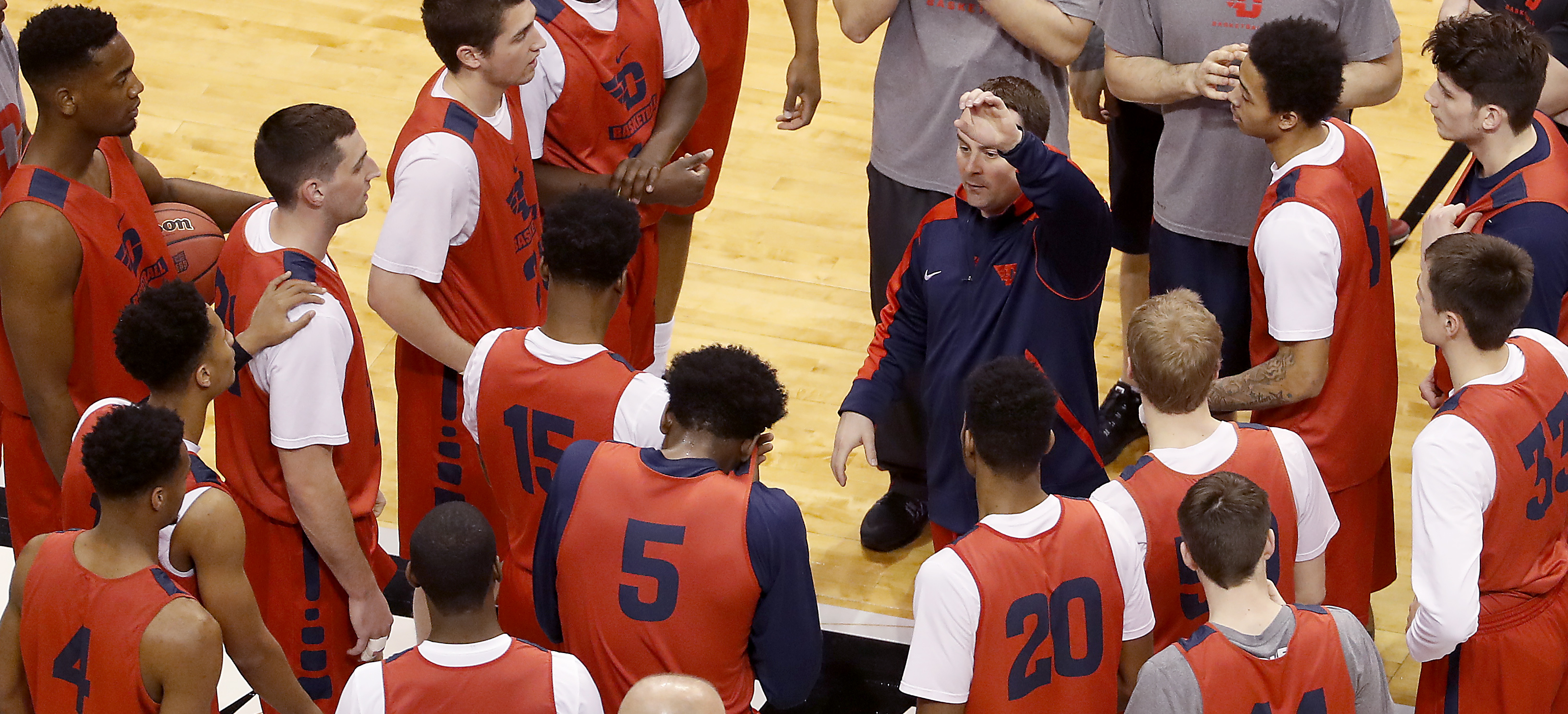 Dayton head coach Archie Miller talks to his players during practice ahead of a first-round men's college basketball game in the NCAA Tournament, Thursday, March 17, 2016, in St. Louis. Dayton plays Syracuse on Friday. (AP Photo/Charlie Riedel)