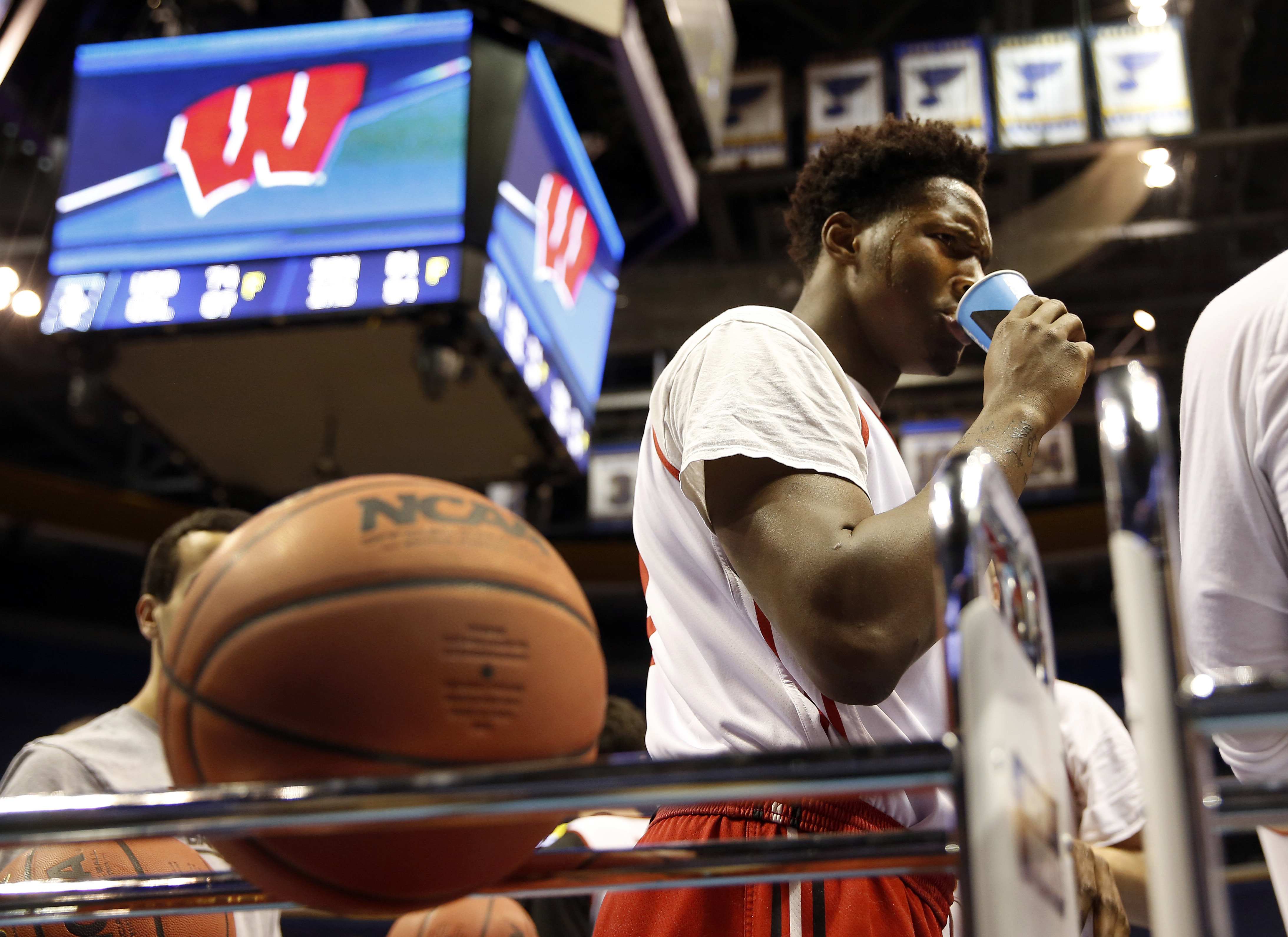 Wisconsin's Nigel Hayes pauses for a drink during practice ahead of a first-round men's college basketball game in the NCAA Tournament on Thursday, March 17, 2016, in St. Louis. Wisconsin plays Pittsburgh on Friday. (AP Photo/Jeff Roberson)
