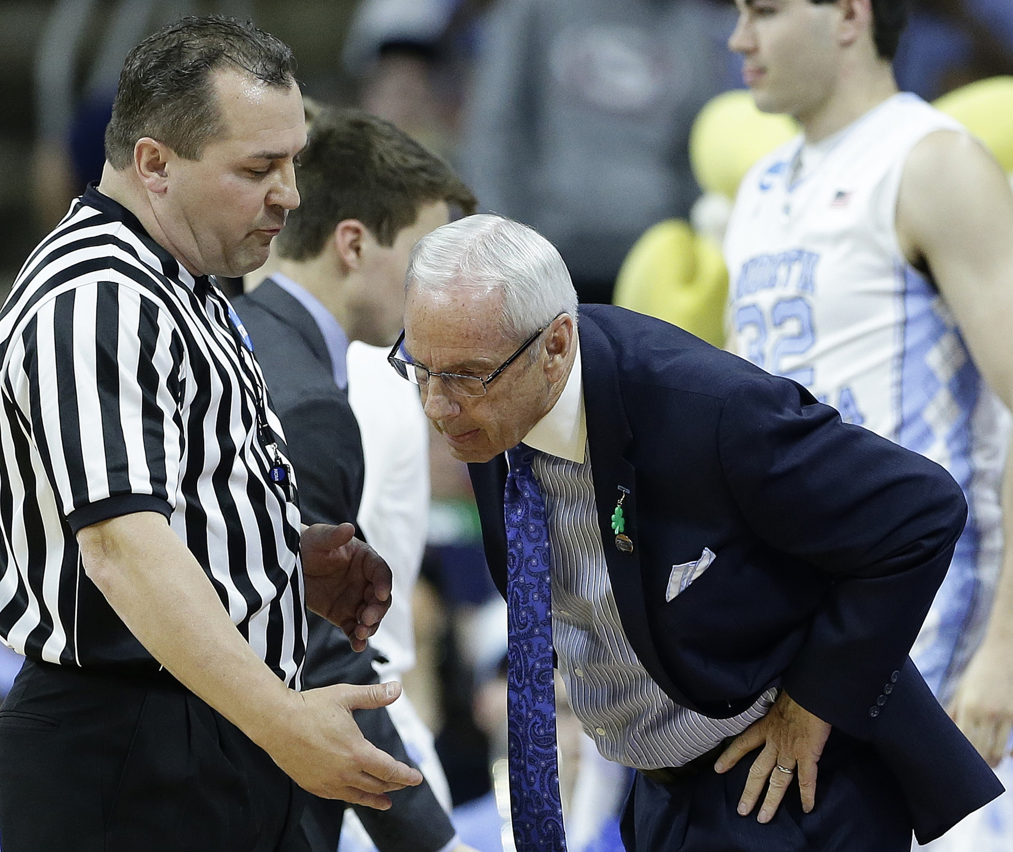 North Carolina head coach Roy Williams speaks to an official during the first half of a first-round men's college basketball game in the NCAA Tournament against Florida Gulf Coast, Thursday, March 17, 2016, in Raleigh, N.C. (AP Photo/Gerry Broome)