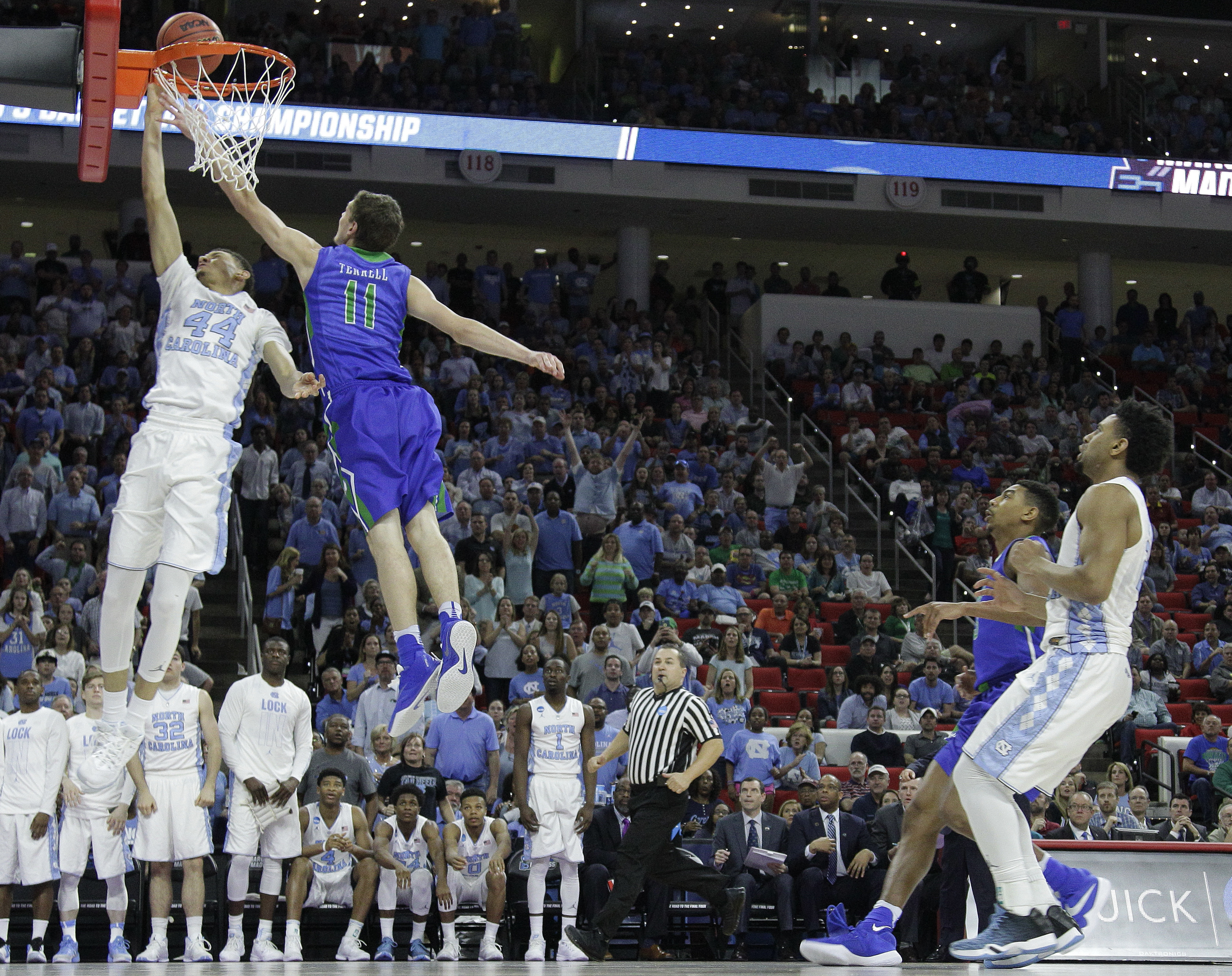 North Carolina forward Justin Jackson (44) shoots over Florida Gulf Coast guard Christian Terrell (11) during the second half of a first-round men's college basketball game in the NCAA Tournament, Thursday, March 17, 2016, in Raleigh, N.C. North Carolina