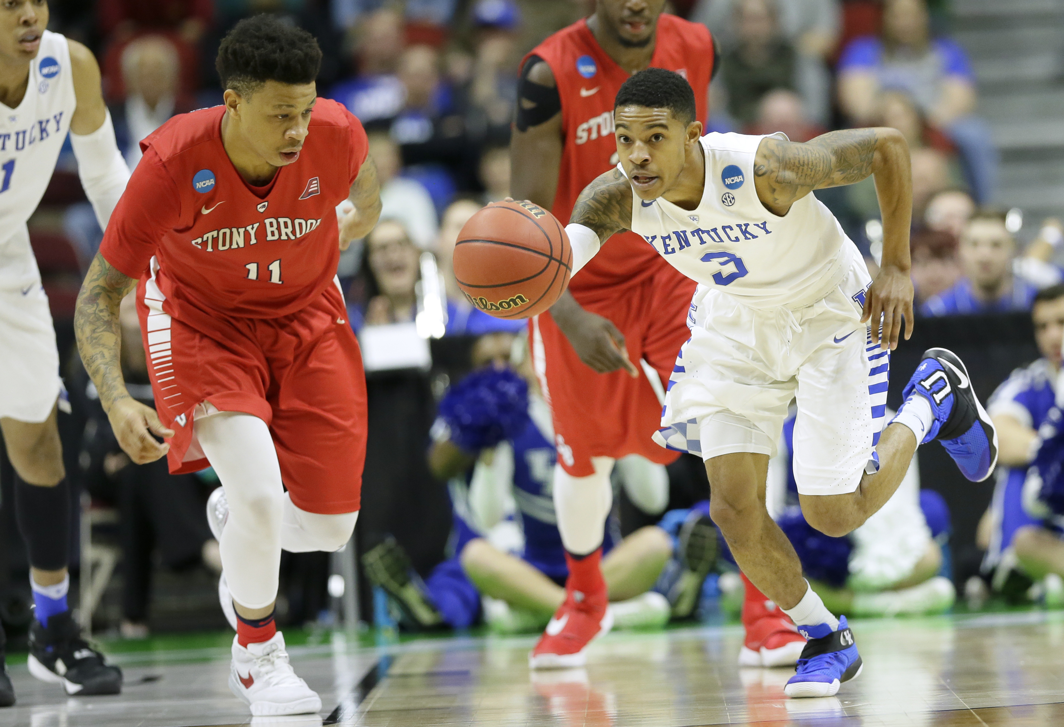 Kentucky guard Tyler Ulis drives upcourt past Stony Brook forward Rayshaun McGrew, left, during the first half of a first-round men's college basketball game in the NCAA Tournament, Thursday, March 17, 2016, in Des Moines, Iowa. (AP Photo/Charlie Neiberga