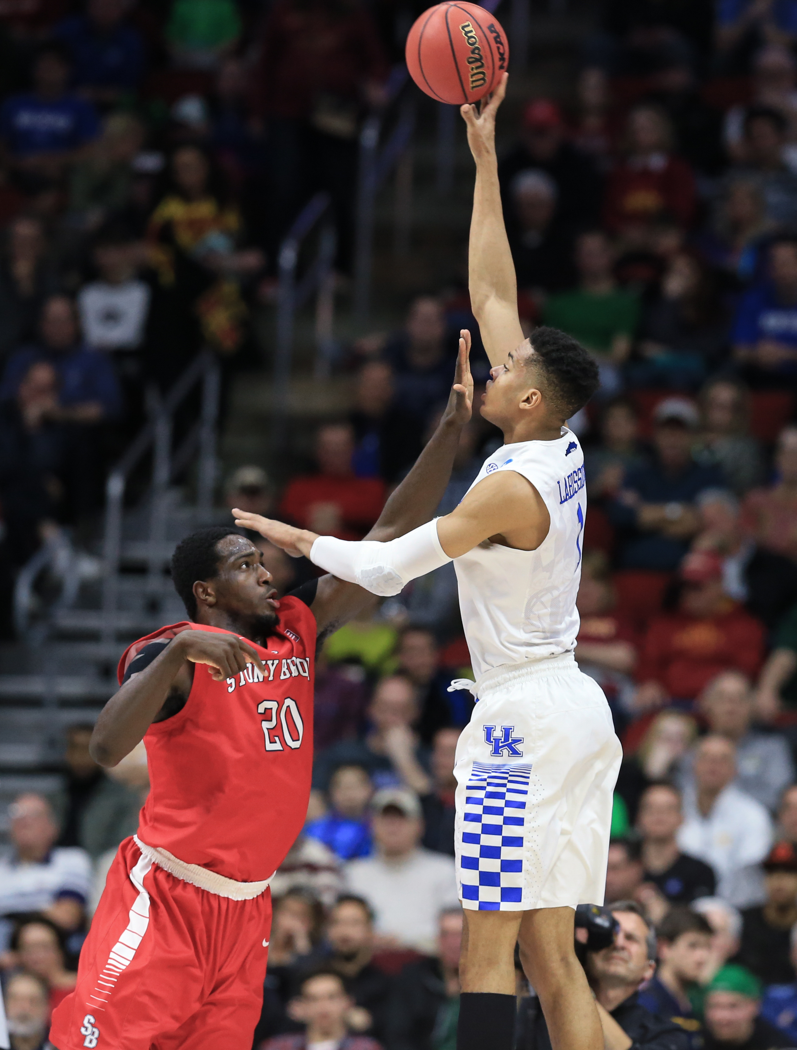 Kentucky's Skal Labissiere (1) shoots over Stony Brook's Jameel Warney (20) during a first-round men's college basketball game in the NCAA Tournament in Des Moines, Iowa, Thursday, March 17, 2016. (AP Photo/Nati Harnik)