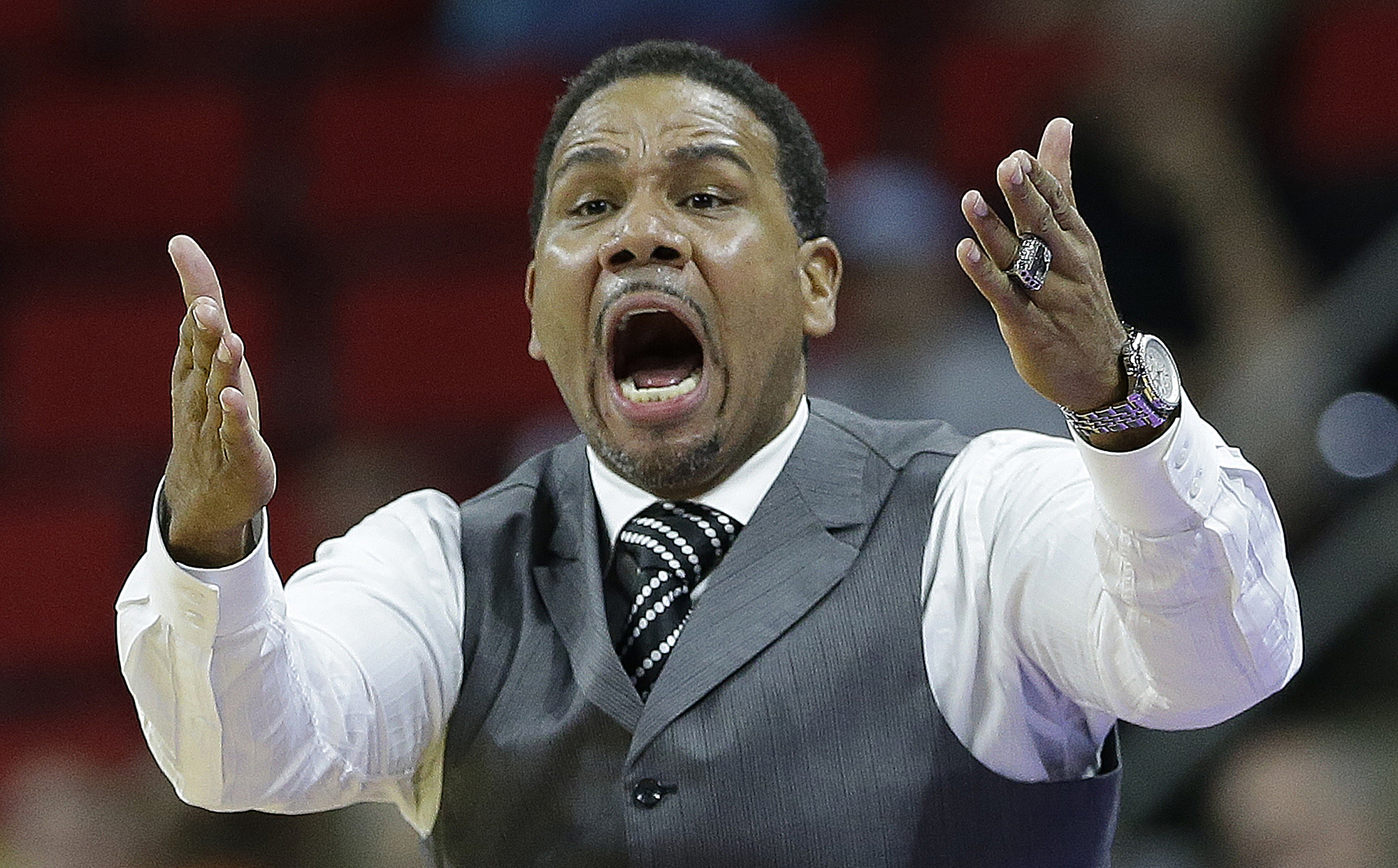 Providence head coach Ed Cooley speaks to his player during the second half of a first-round men's college basketball game in the NCAA Tournament against Southern California, Thursday, March 17, 2016, in Raleigh, N.C.  (AP Photo/Gerry Broome)