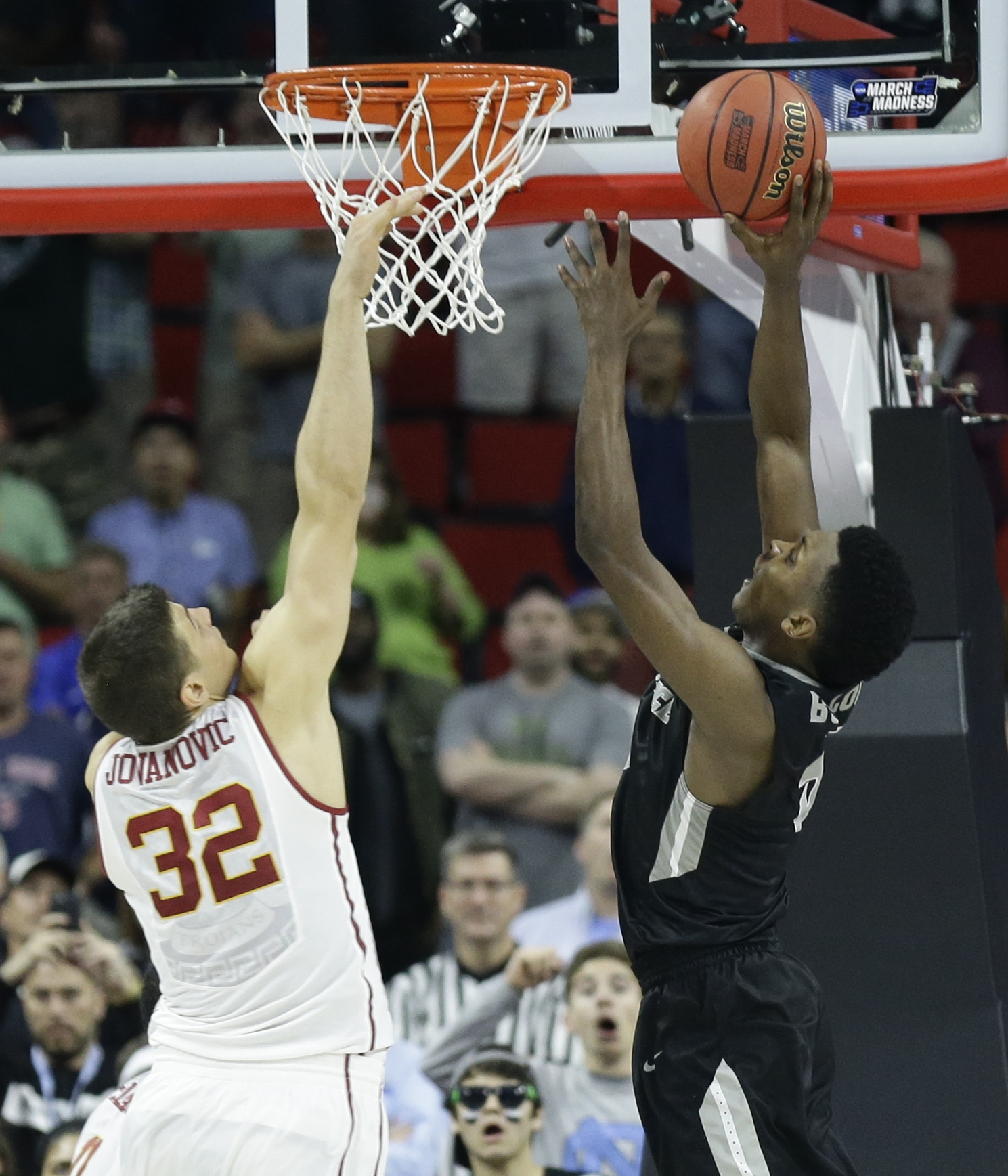 Providence forward Rodney Bullock (5) shoots the winning basket against Southern California forward Nikola Jovanovic (32) during the second half of a first-round men's college basketball game in the NCAA Tournament, Friday, March 18, 2016, in Raleigh, N.C