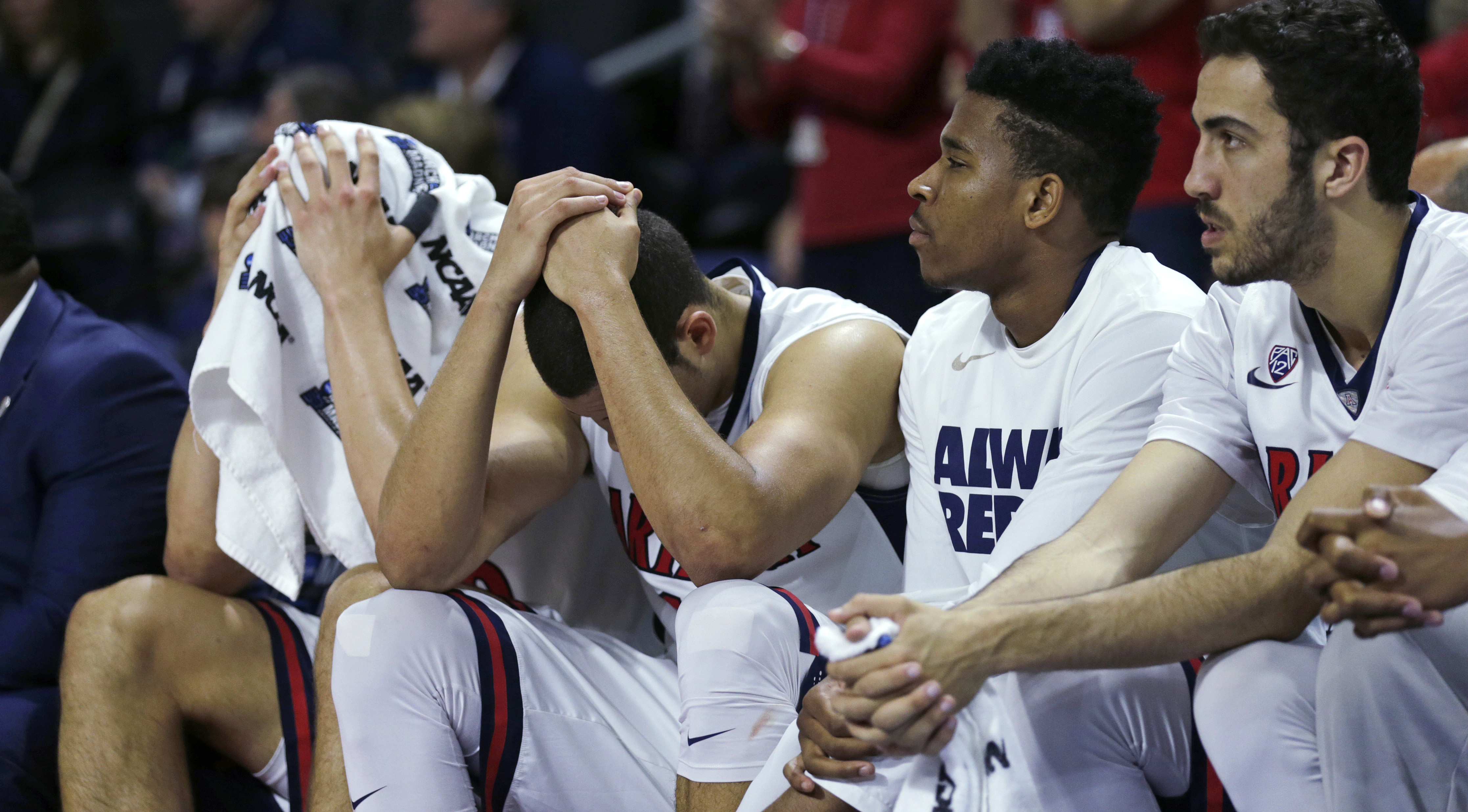 Arizona players cover their heads in the closing minute against Wichita State during the first round of the NCAA college men's basketball tournament in Providence, R.I., Thursday, March 17, 2016. Wichita State defeated Arizona 65-55. (AP Photo/Charles Kru