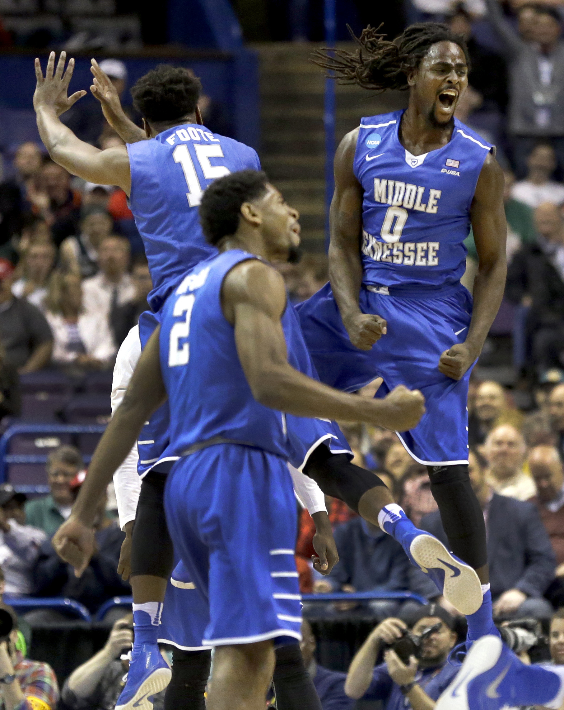 Middle Tennessee's Darnell Harris (0), Perrin Buford (2) and Aldonis Foote (15) celebrate during the first half in a first-round men's college basketball game against Michigan State in the NCAA tournament, Friday, March 18, 2016, in St. Louis. (AP Photo/J