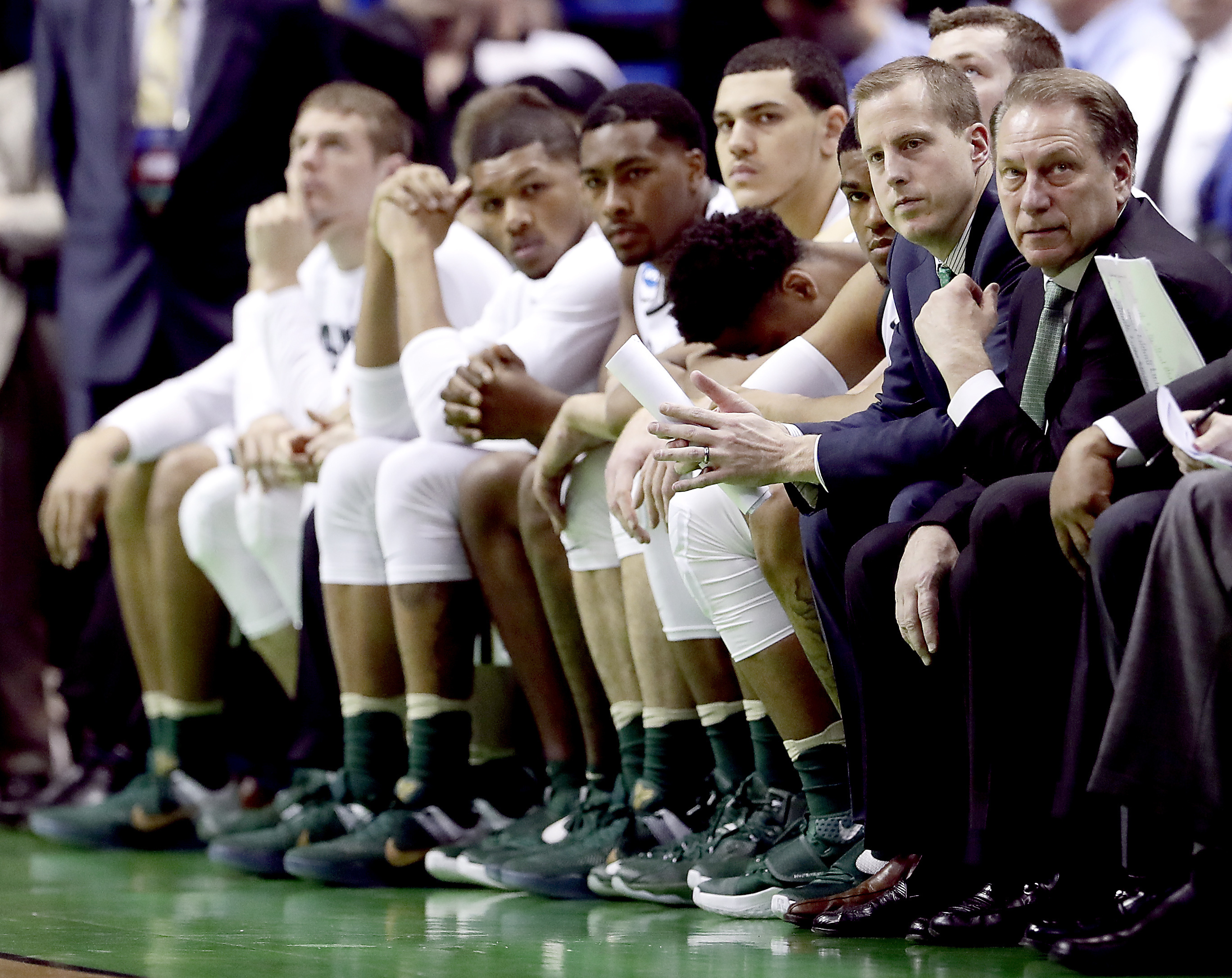 The Michigan State bench watches during the final moments of a first-round men's college basketball game against Middle Tennessee in the NCAA Tournament, Friday, March 18, 2016, in St. Louis. Middle Tennessee won 90-81. (AP Photo/Charlie Riedel)