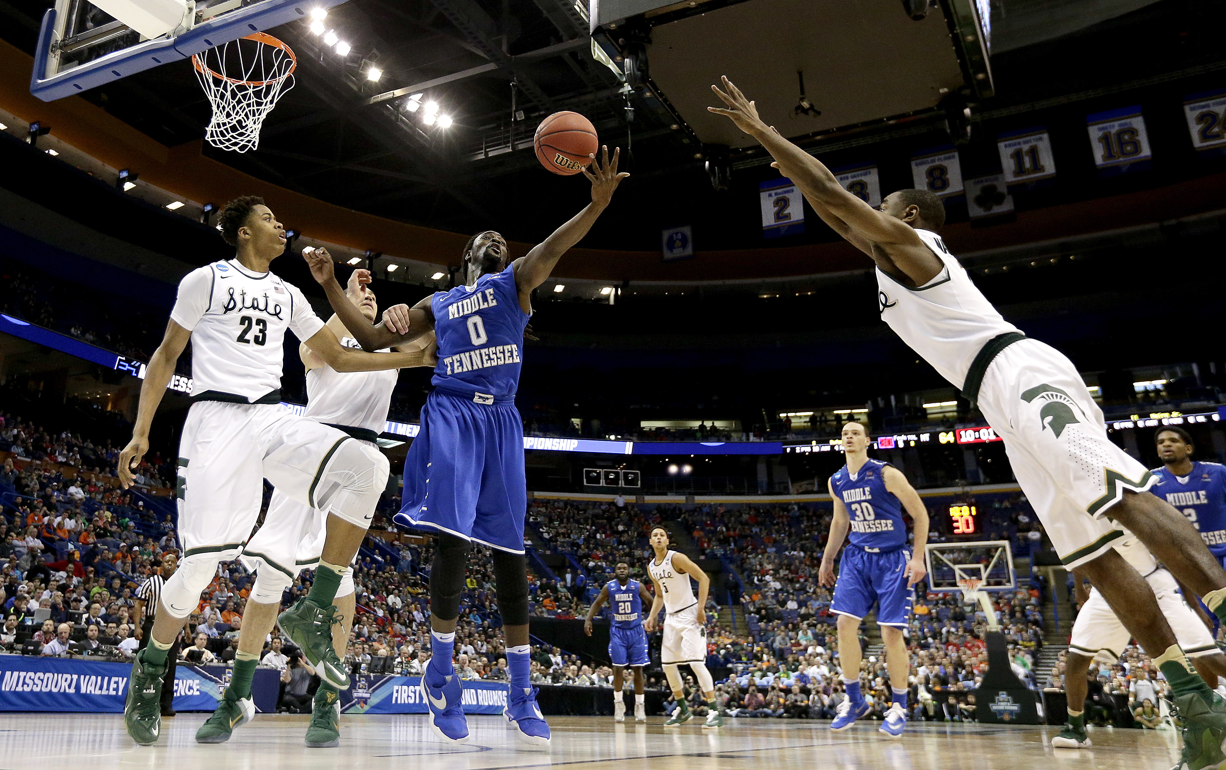 Middle Tennessee's Darnell Harris (0) beats Michigan State's Deyonta Davis (23) to a rebound during the second half of a first-round men's college basketball game in the NCAA Tournament, Friday, March 18, 2016, in St. Louis. Middle Tennessee won 90-81. (A