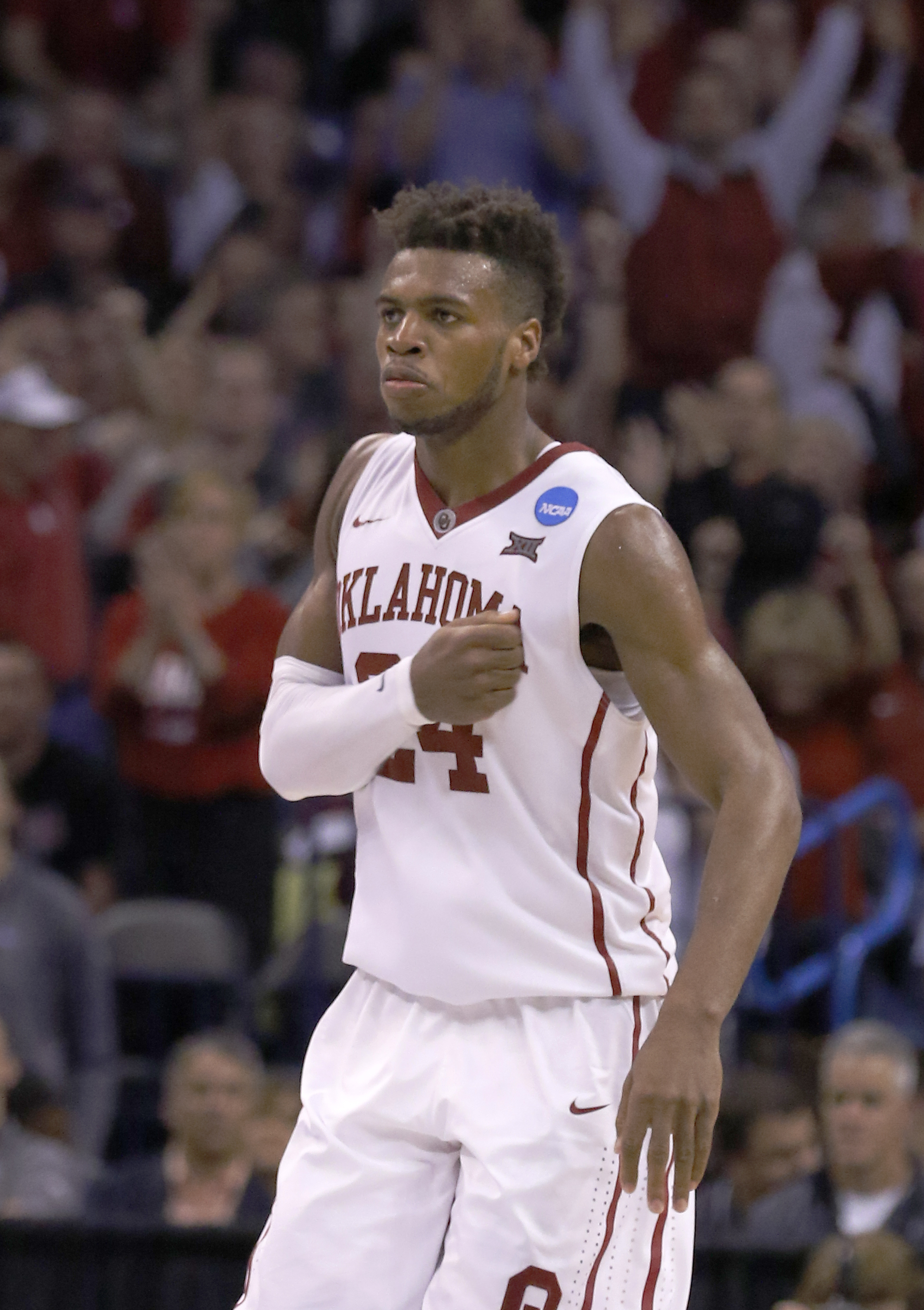 Oklahoma guard Buddy Hield (24) reacts after making a 3-point basket during the second half against Cal State Bakersfield during a first-round men's college basketball game in the NCAA Tournament in Oklahoma City, Friday, March 18, 2016. Oklahoma won 82-6