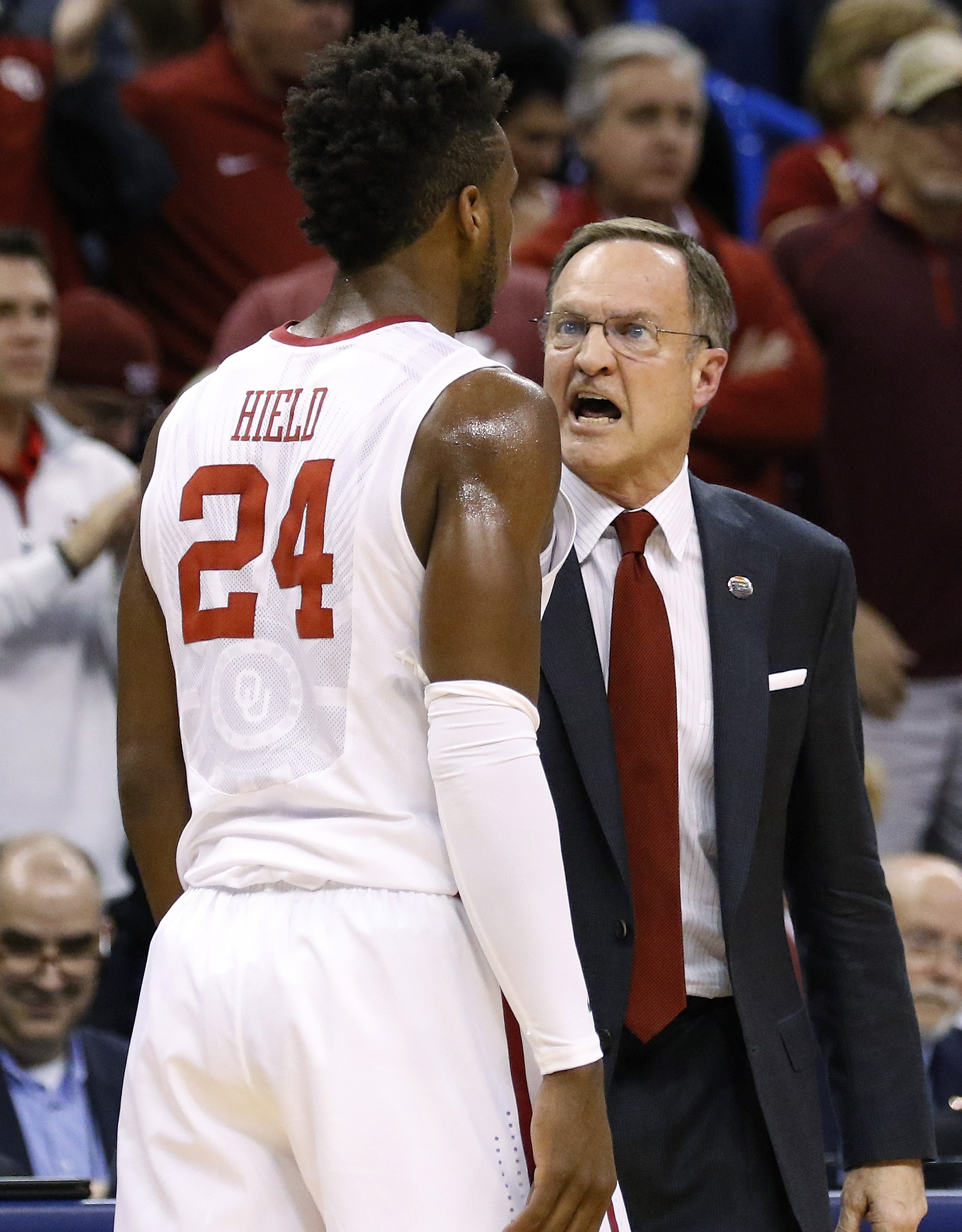 Oklahoma coach Lon Kruger talks to guard Buddy Hield during the first half of a first-round men's college basketball game against Cal State Bakersfield in the NCAA Tournament, Friday, March 18, 2016, in Oklahoma City. Oklahoma won 82-68. (AP Photo/Alonzo