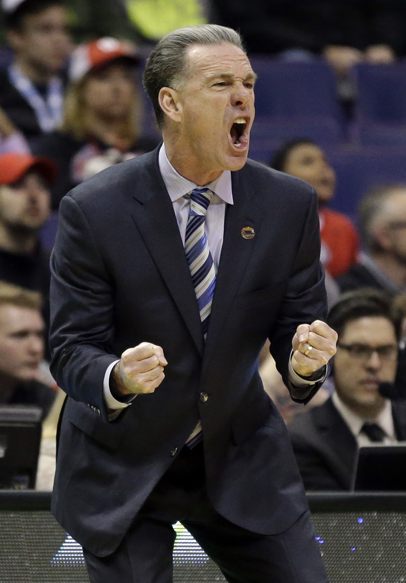 Pittsburgh coach Jamie Dixon yells on the sideline during the first half of a first-round men's college basketball game against Wisconsin in the NCAA tournament, Friday, March 18, 2016, in St. Louis. (AP Photo/Jeff Roberson)