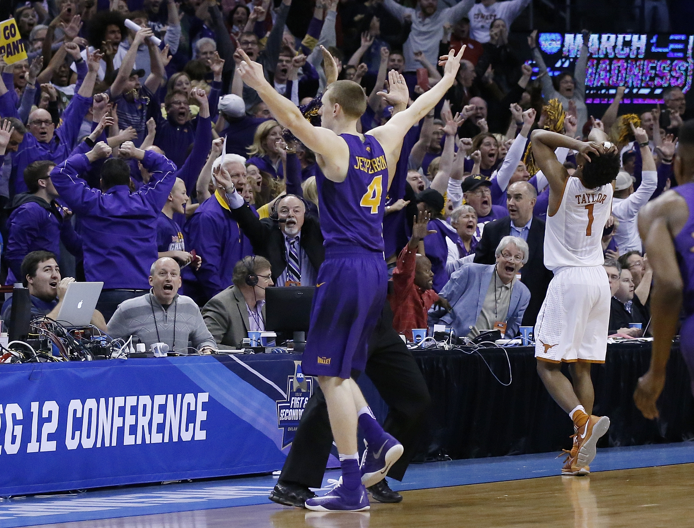 Northern Iowa guard Paul Jesperson gestures to fans after hitting the game-winning shot against Texas in a first-round men's college basketball game in the NCAA Tournament, Friday, March 18, 2016, in Oklahoma City. Texas guard Isaiah Taylor is at right. N