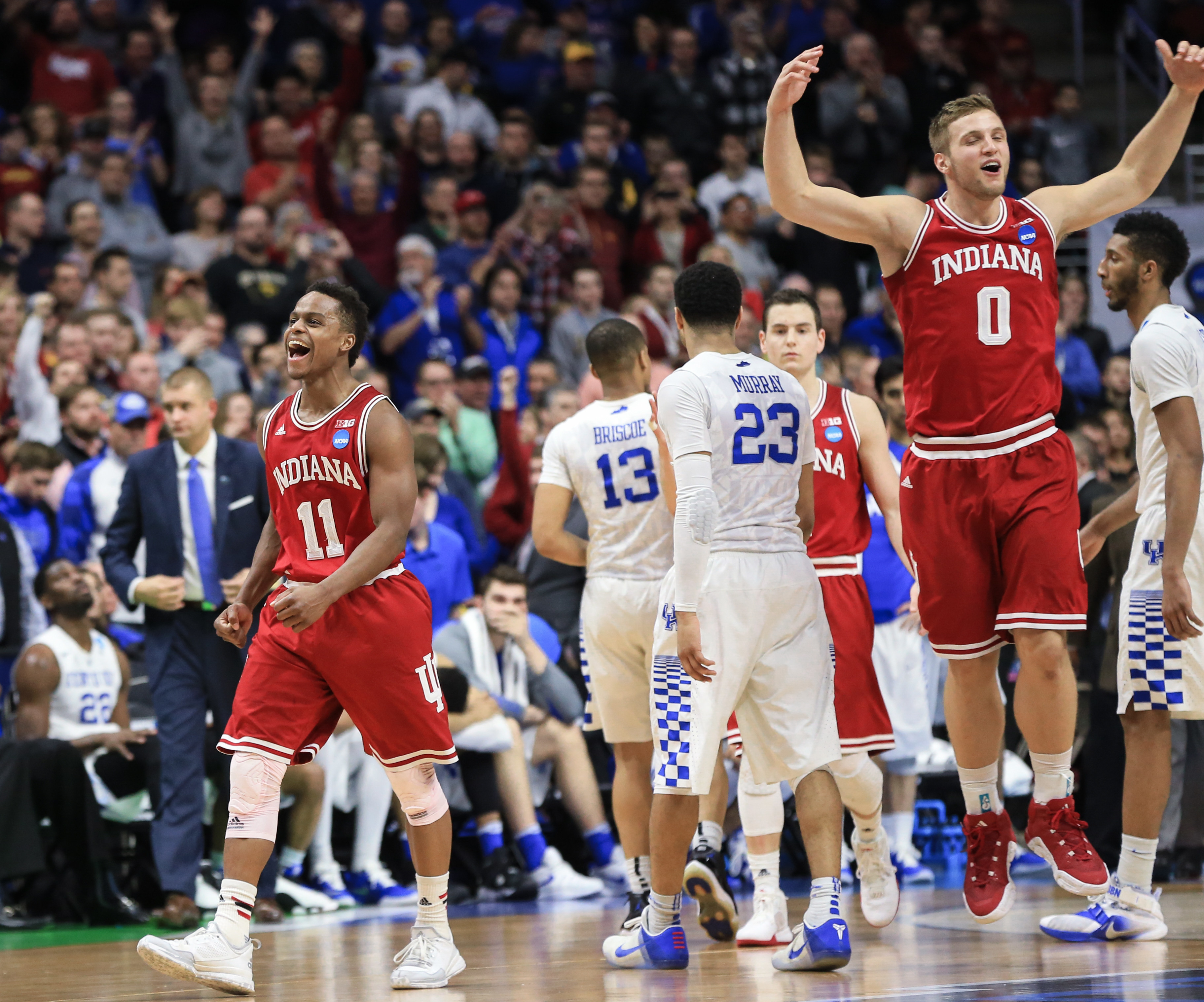 Indiana's Kevin Yogi Ferrell (11) and Max Bielfeldt (0) celebrate the team's 73-67 win over Kentucky in a second-round men's college basketball game in the NCAA Tournament in Des Moines, Iowa, Saturday, March 19, 2016. (AP Photo/Nati Harnik)