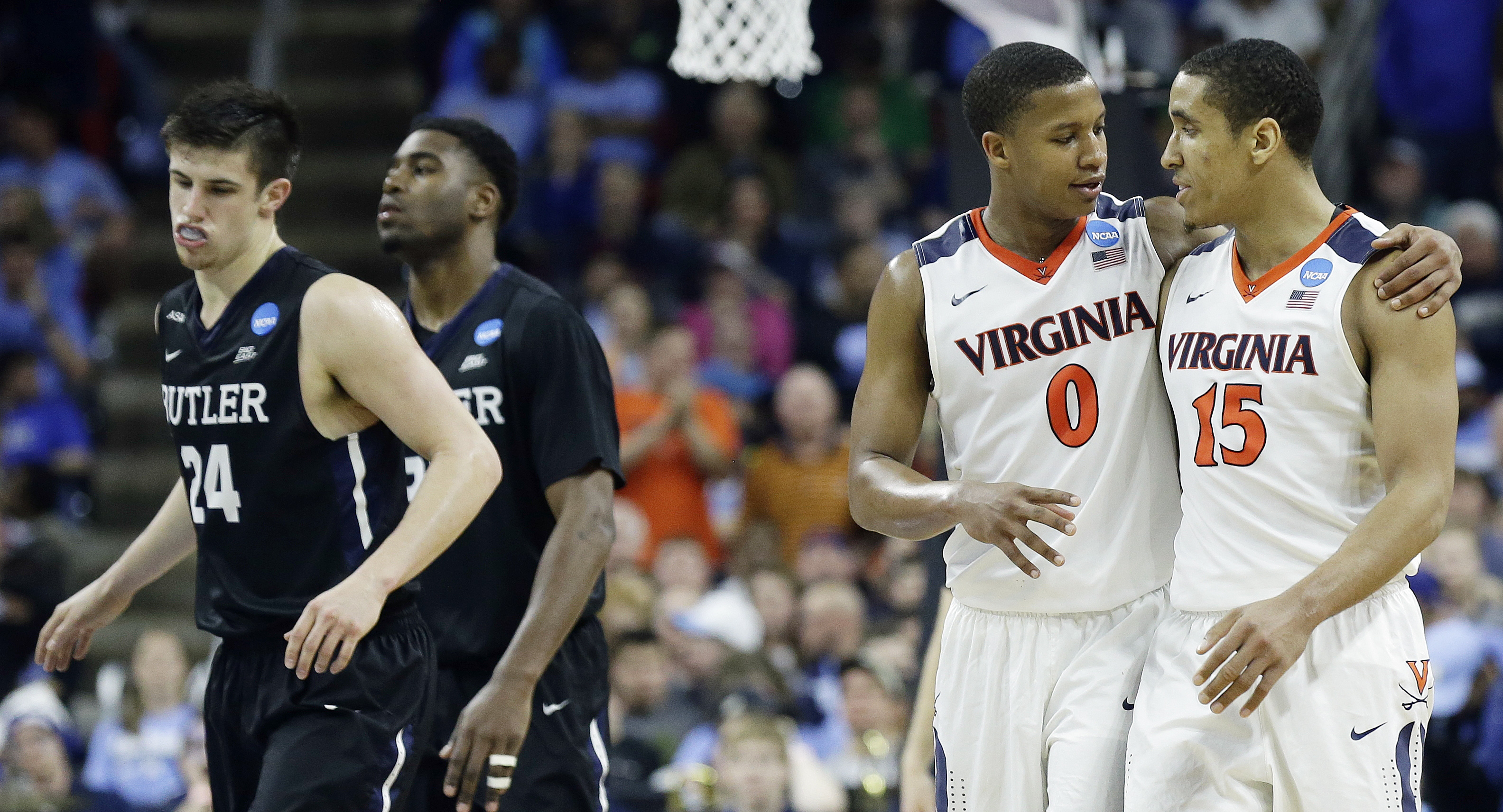 Virginia guard Devon Hall (0) speaks with Virginia guard Malcolm Brogdon (15) after the second half of a second-round men's college basketball game in the NCAA Tournament against Butler, Saturday, March 19, 2016, in Raleigh, N.C. Virginia won 77-69. (AP P