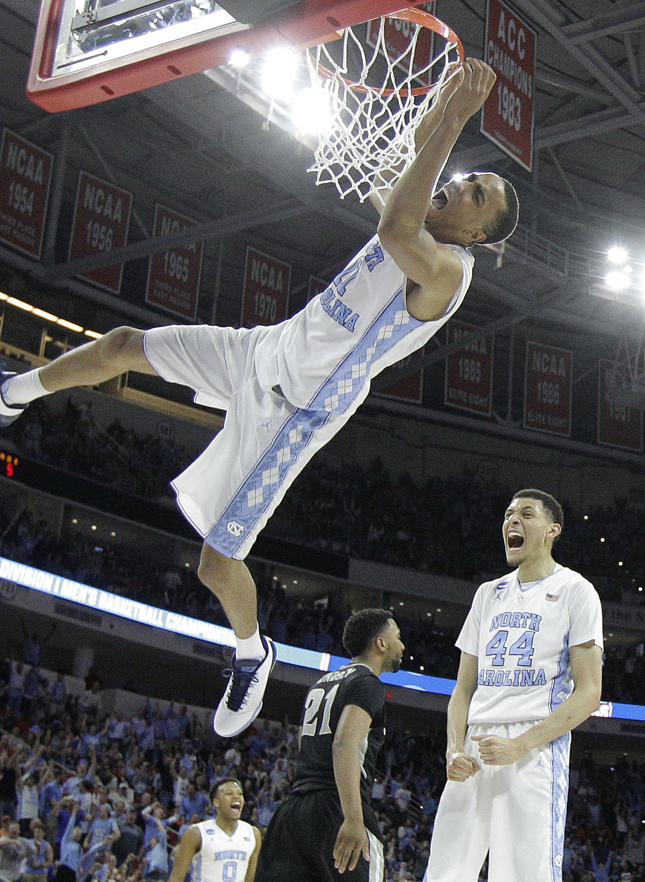 North Carolina forward Brice Johnson (11) celebrates with North Carolina forward Justin Jackson (44) after Johnson dunked the ball against Providence during the second half of a second-round men's college basketball game in the NCAA Tournament, Saturday,
