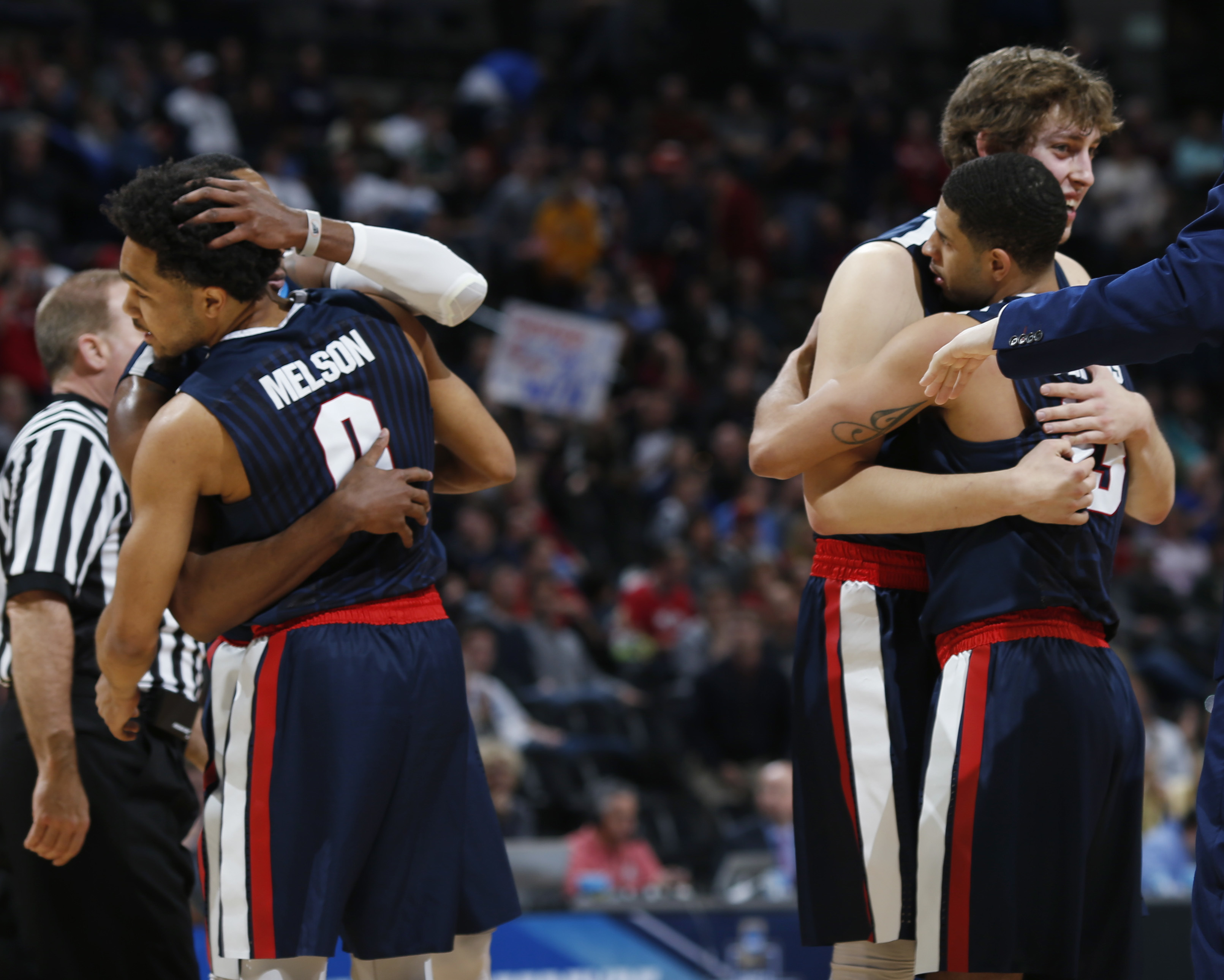 Gonzaga guard Silas Melson, front left, hugs guard Eric McClellan as guard Josh Perkins, front right, hugs forward Kyle Wiltjer late in the second half of a second-round men's college basketball game against Utah on Saturday, March 19, 2016, in the NCAA T