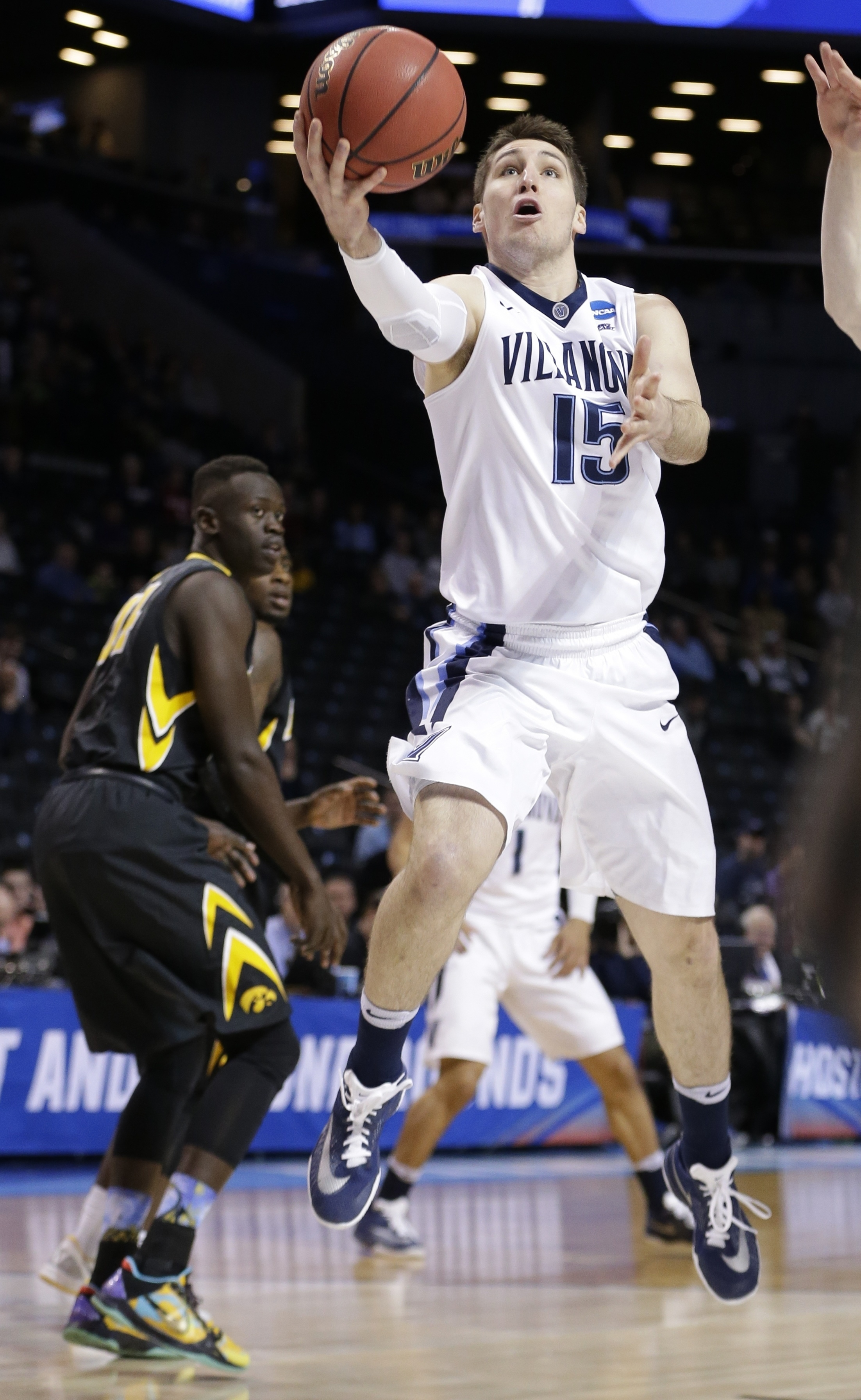 Villanova's Ryan Arcidiacono (15) drives past Iowa's Peter Jok (14) during the first half of a second-round men's college basketball game in the NCAA Tournament, Sunday, March 20, 2016, in New York. (AP Photo/Frank Franklin II)