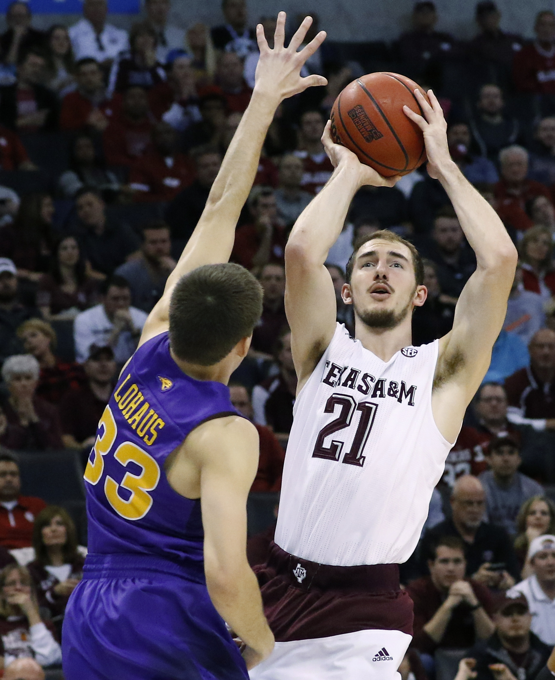 Texas A&M guard Alex Caruso (21) shoots over Northern Iowa guard Wyatt Lohaus (33) in the first half of a second-round men's college basketball game in the NCAA Tournament Sunday, March 20, 2016, in Oklahoma City. Oklahoma won 85-81. (AP Photo/Alonzo Adam