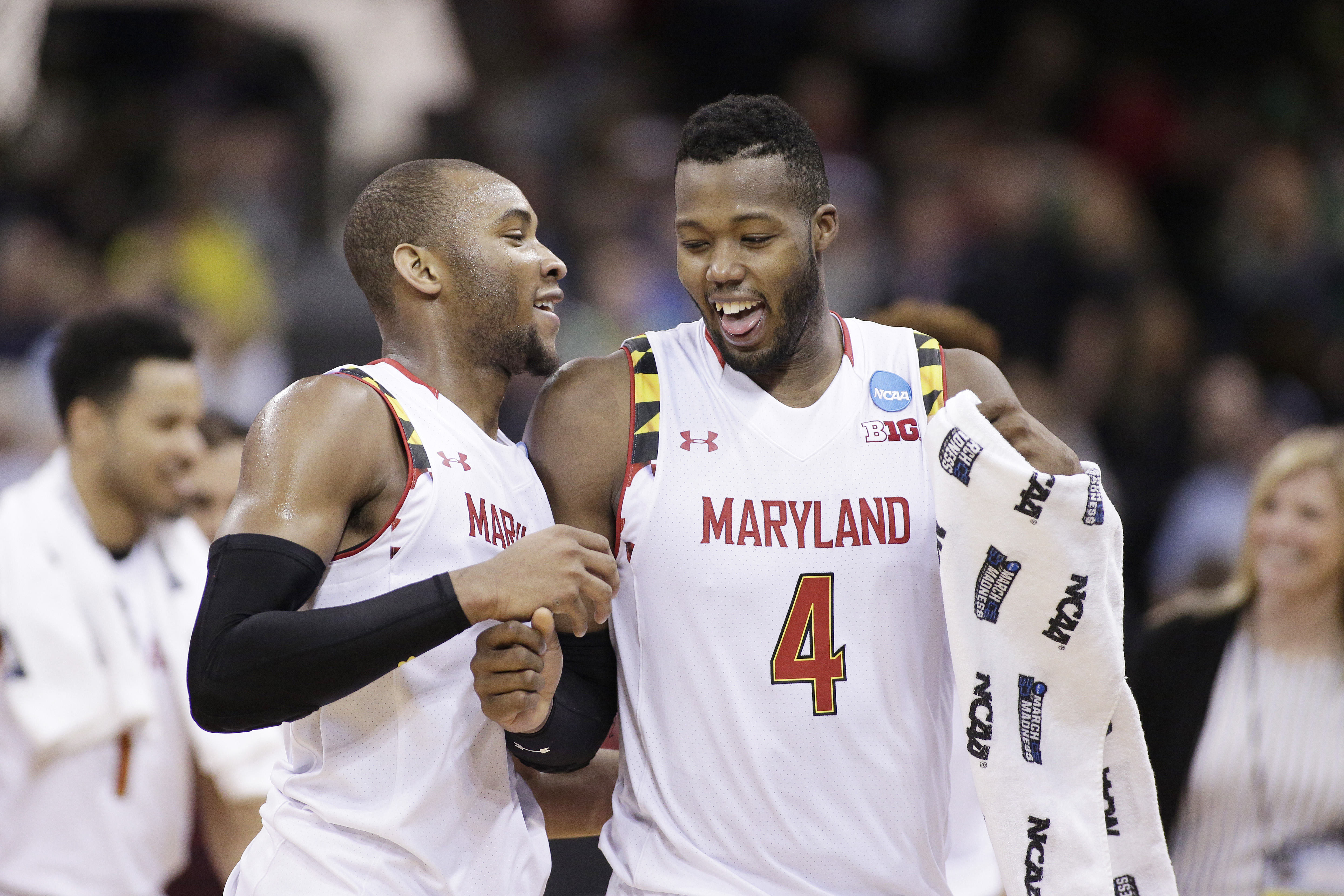 Maryland forward Robert Carter (4) and guard Rasheed Sulaimon celebrate after winning a second-round men's college basketball game against Hawaii in the NCAA Tournament in Spokane, Wash., Sunday, March 20, 2016. Maryland won 73-60. (AP Photo/Young Kwak)