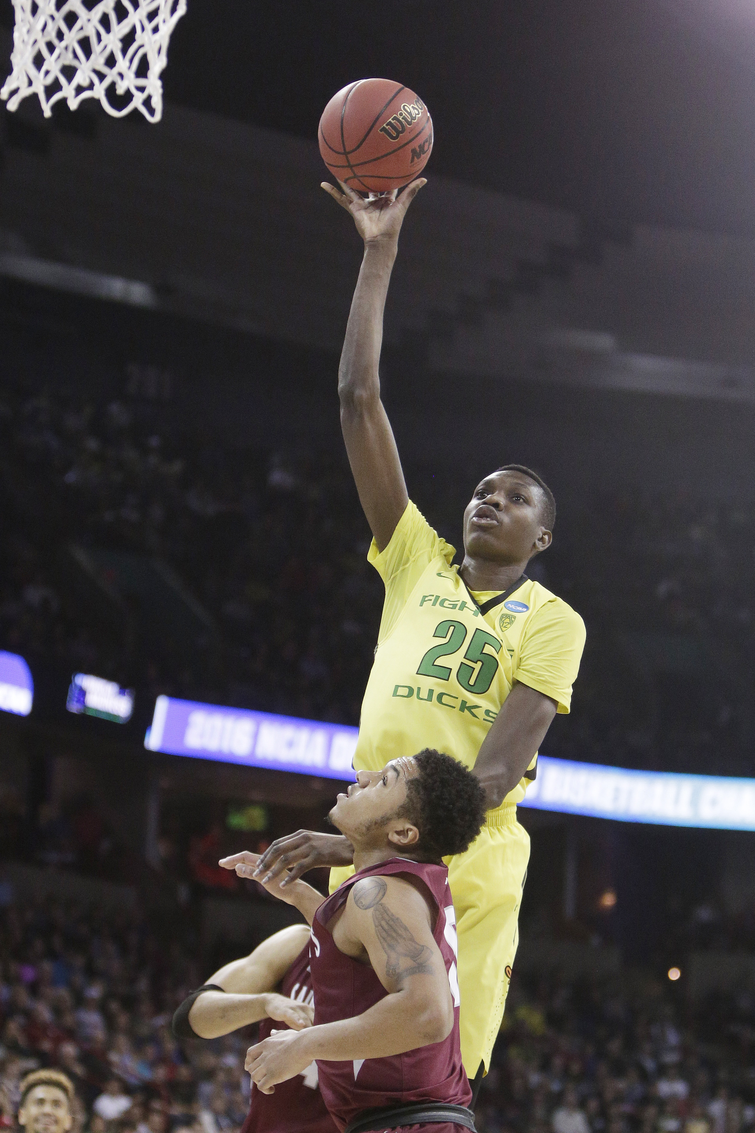 Oregon forward Chris Boucher (25) shoots against Saint Joseph's guard Lamarr Kimble during the first half of a second-round men's college basketball game in the NCAA Tournament in Spokane, Wash., Sunday, March 20, 2016. (AP Photo/Young Kwak)