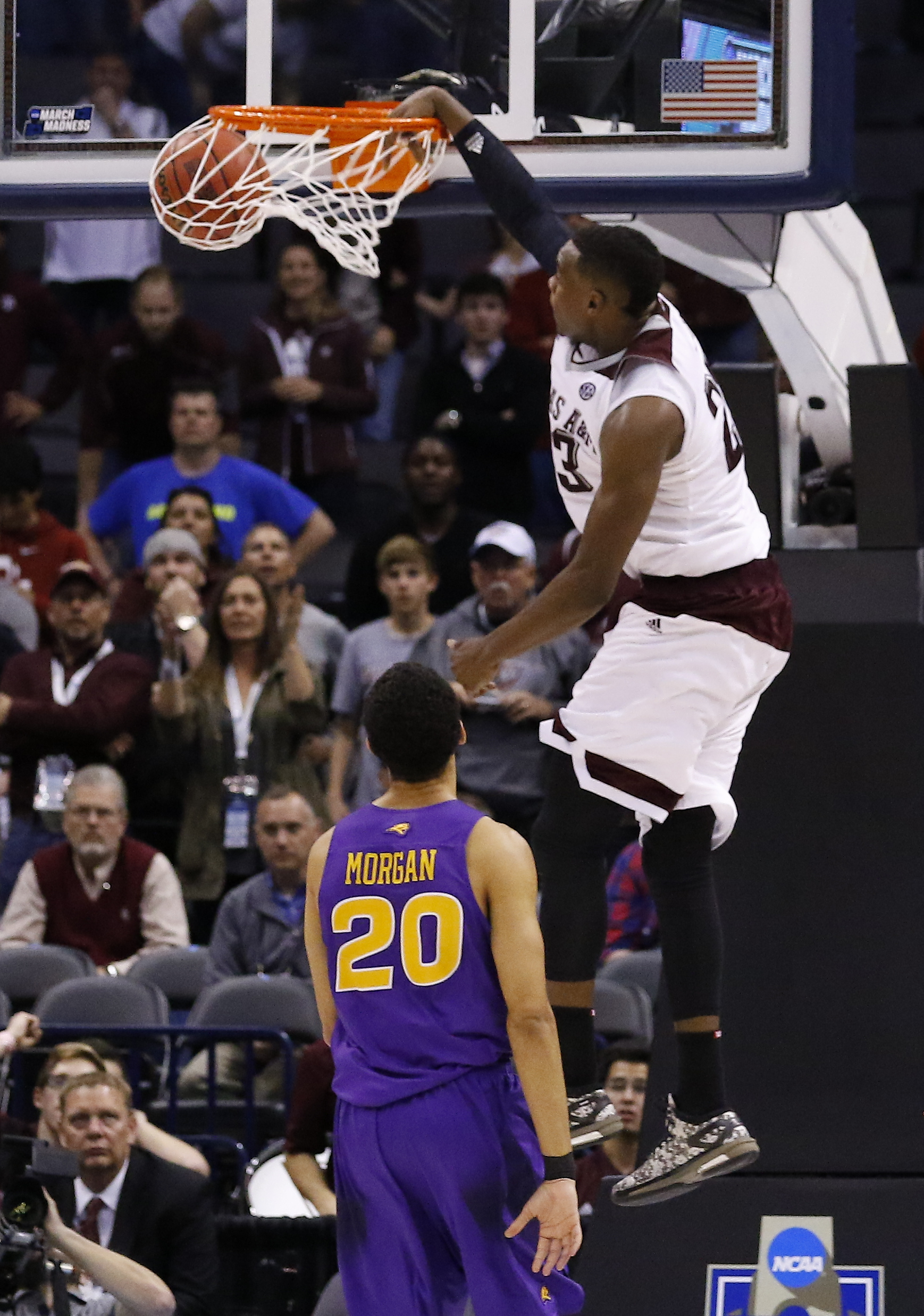Texas A&M guard Danuel House (23) goes up for a dunk as Northern Iowa guard Jeremy Morgan (20) looks on in the second half during a second-round men's college basketball game in the NCAA Tournament in Oklahoma City, Sunday, March 20, 2016. Texas A&M won i