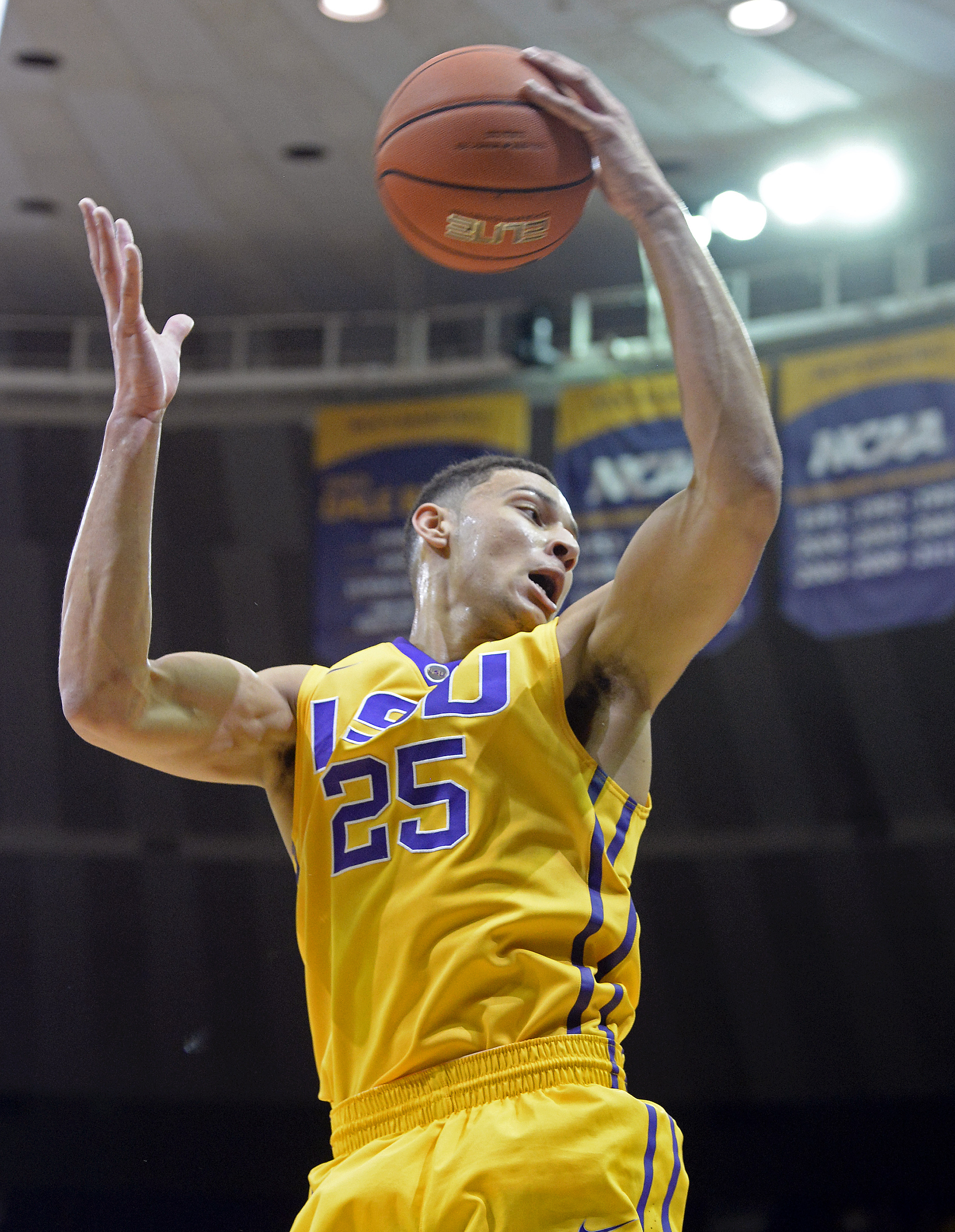 FILE - In this Feb. 13, 2016, file photo, LSU forward Ben Simmons (25) pulls in a rebound in the first half of an NCAA college basketball game against Texas A&M,  in Baton Rouge, La. LSU freshman forward Ben Simmons, who led the Tigers in scoring, rebound
