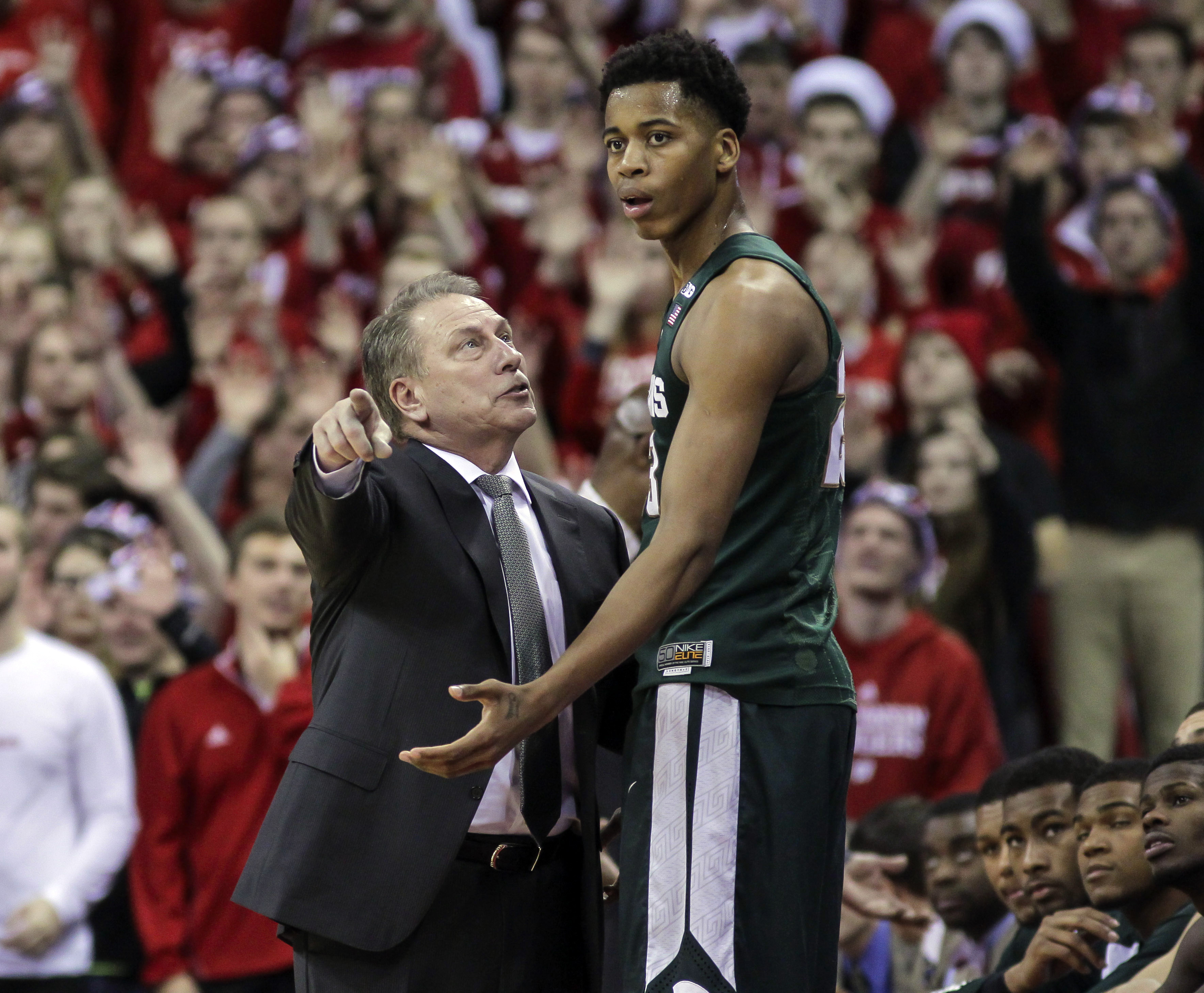 FILE - In this Jan. 17, 2016, file photo, Michigan State coach Tom Izzo talks with Deyonta Davis during an NCAA college basketball game against Wisconsin, in Madison, Wisc. Michigan State coach Tom Izzo says he will assist freshman Deyonta Davis as he con