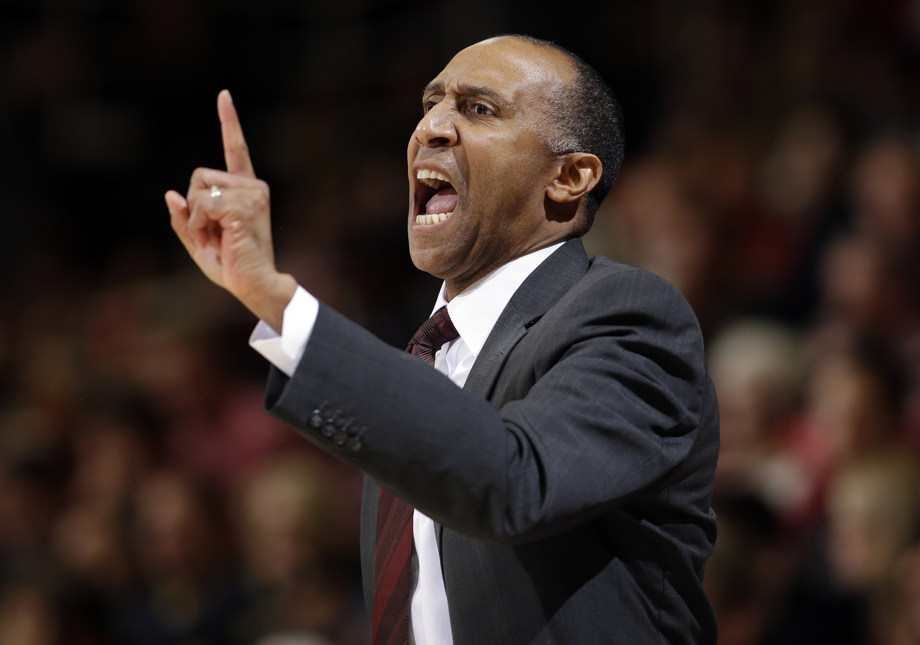 FILE - In this Jan. 14, 2016, file photo, Stanford head coach Johnny Dawkins talks to his players during the first half of an NCAA college basketball game against California in Stanford, Calif. A person familiar with the situation says UCF has hired Johnn
