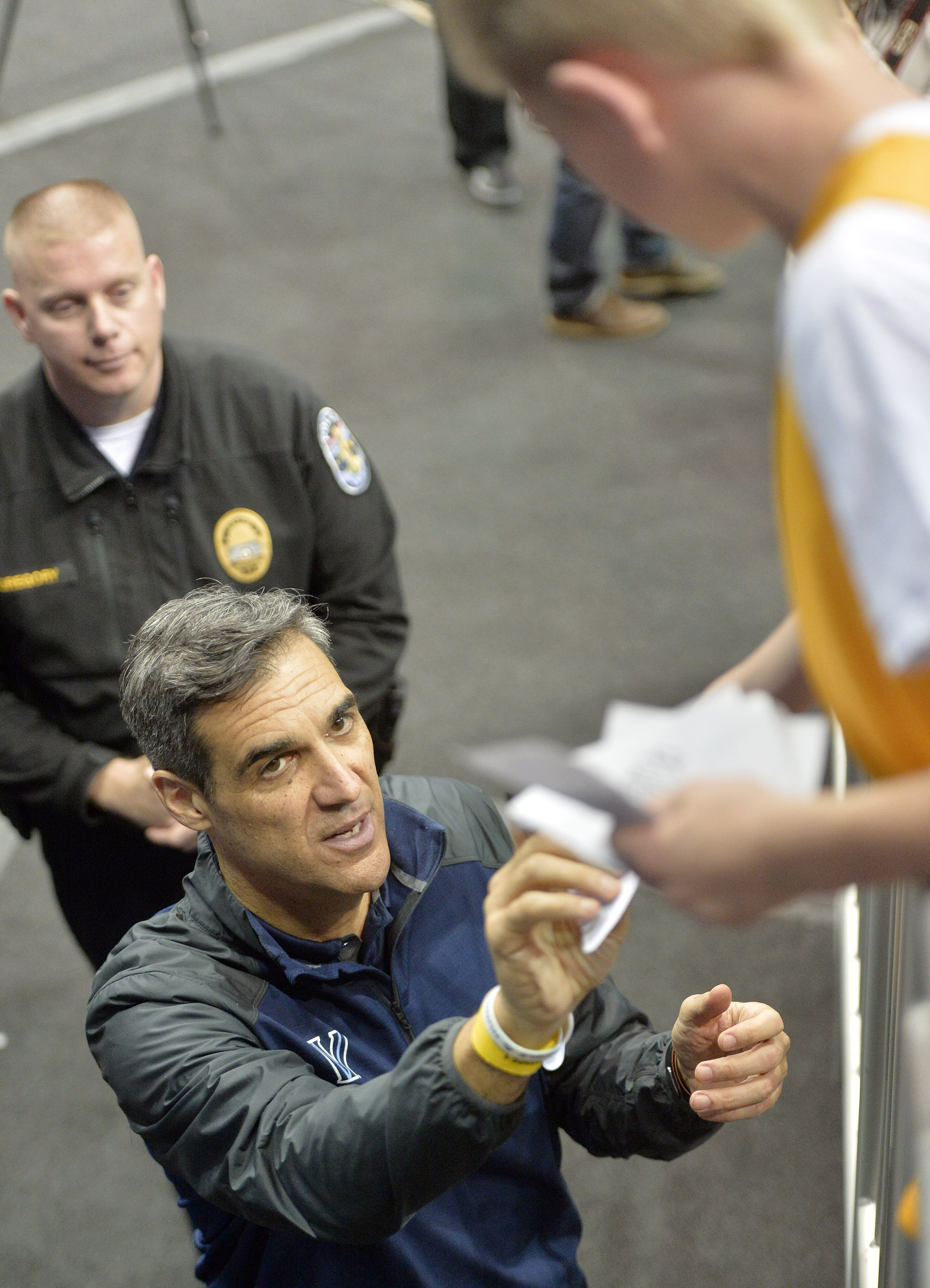 Villanova head coach Jay Wright signs an autograph for a fan following college basketball practice for a regional semifinal game in the NCAA Tournament, Wednesday, March 23, 2016, in Louisville, Ky. Villanova plays against Miami on Thursday. (AP Photo/Tim