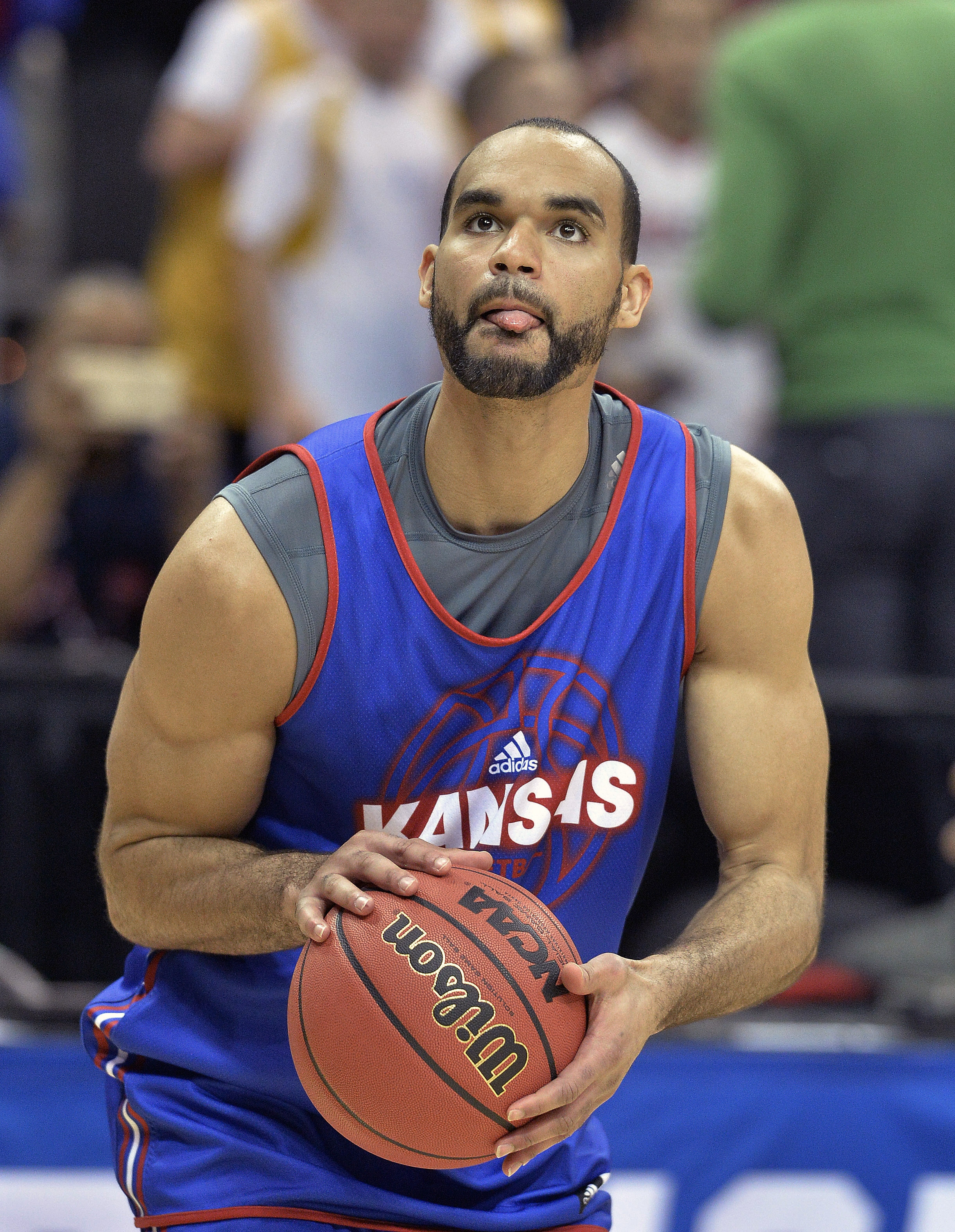 Kansas forward Perry Ellis (34) shoots during a college basketball practice in Louisville, Ky.,  Wednesday, March 23, 2016. Kansas plays Maryland in a regional semifinal game in the NCAA Tournament on Thursday. (AP Photo/Timothy D. Easley)