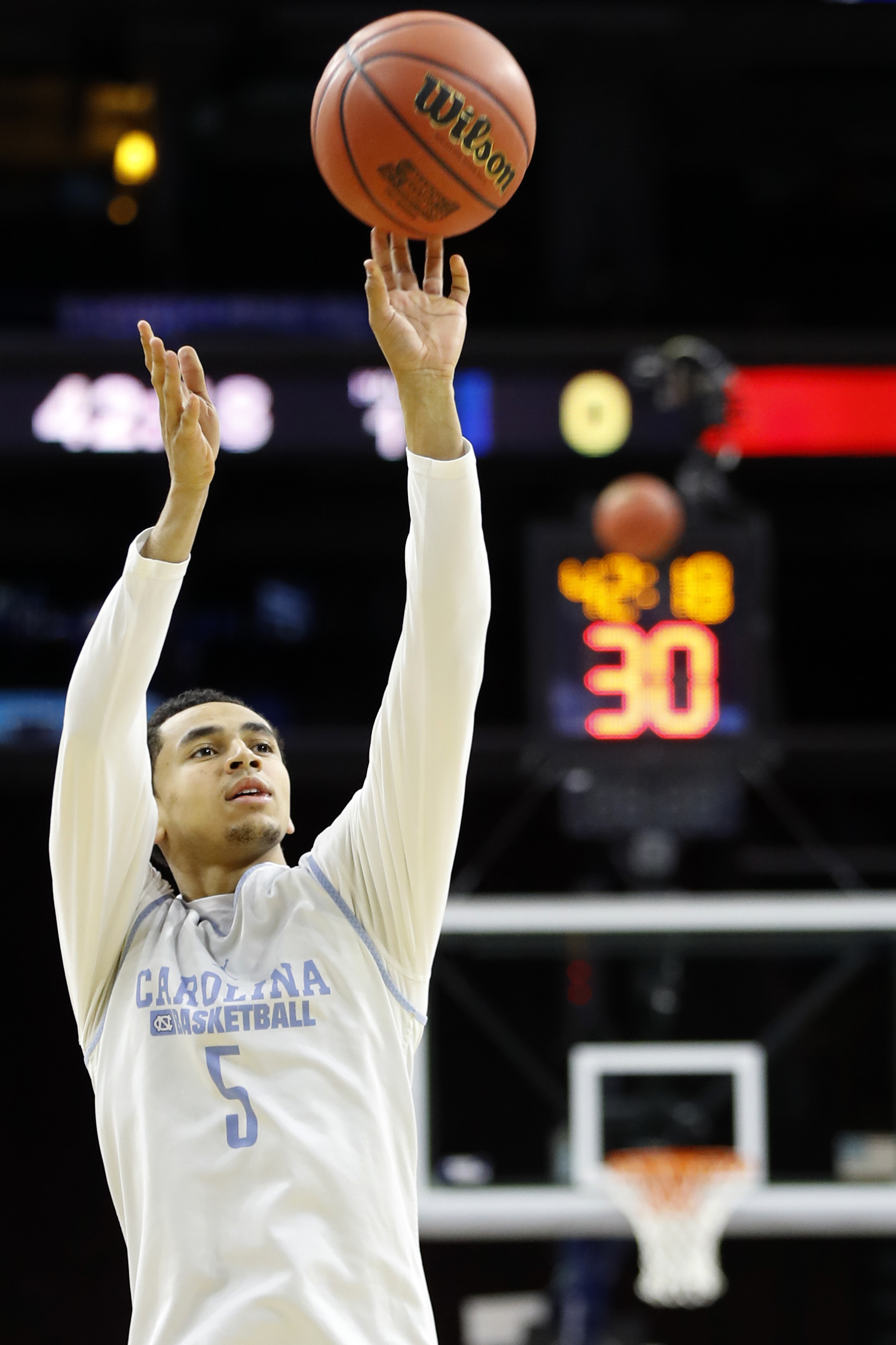 North Carolina's Marcus Paige takes a shot during college basketball practice, Thursday, March 24, 2016, in Philadelphia. North Carolina plays against Indiana in a regional semifinal game in the NCAA Tournament on Friday. (AP Photo/Chris Szagola)