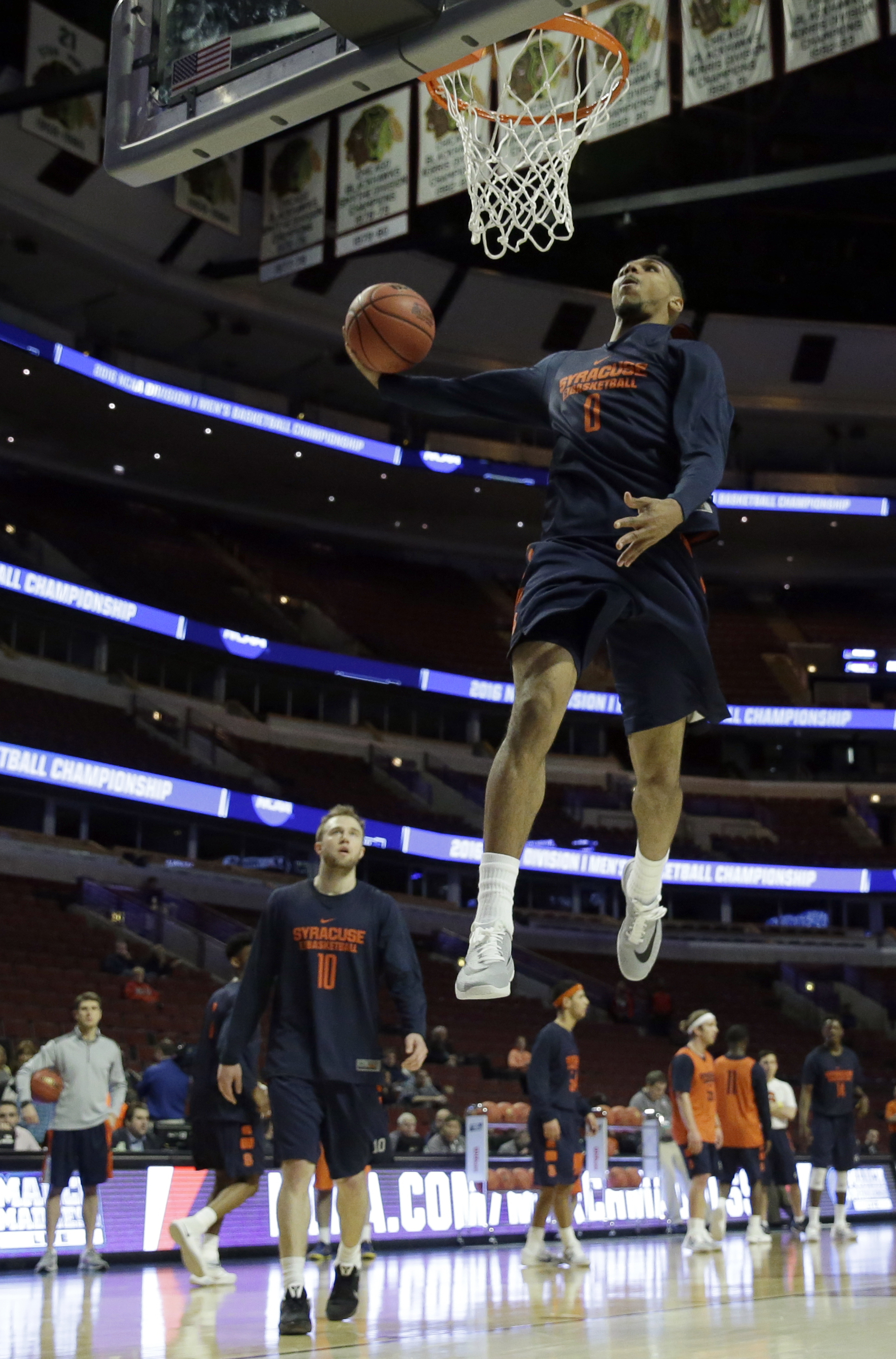 Syracuse's Michael Gbinije (0) goes up for a shot during college basketball practice, Thursday, March 24, 2016, in Chicago. Syracuse plays against Gonzaga in a regional semifinal game in the NCAA Tournament on Friday. (AP Photo/Nam Y. Huh)