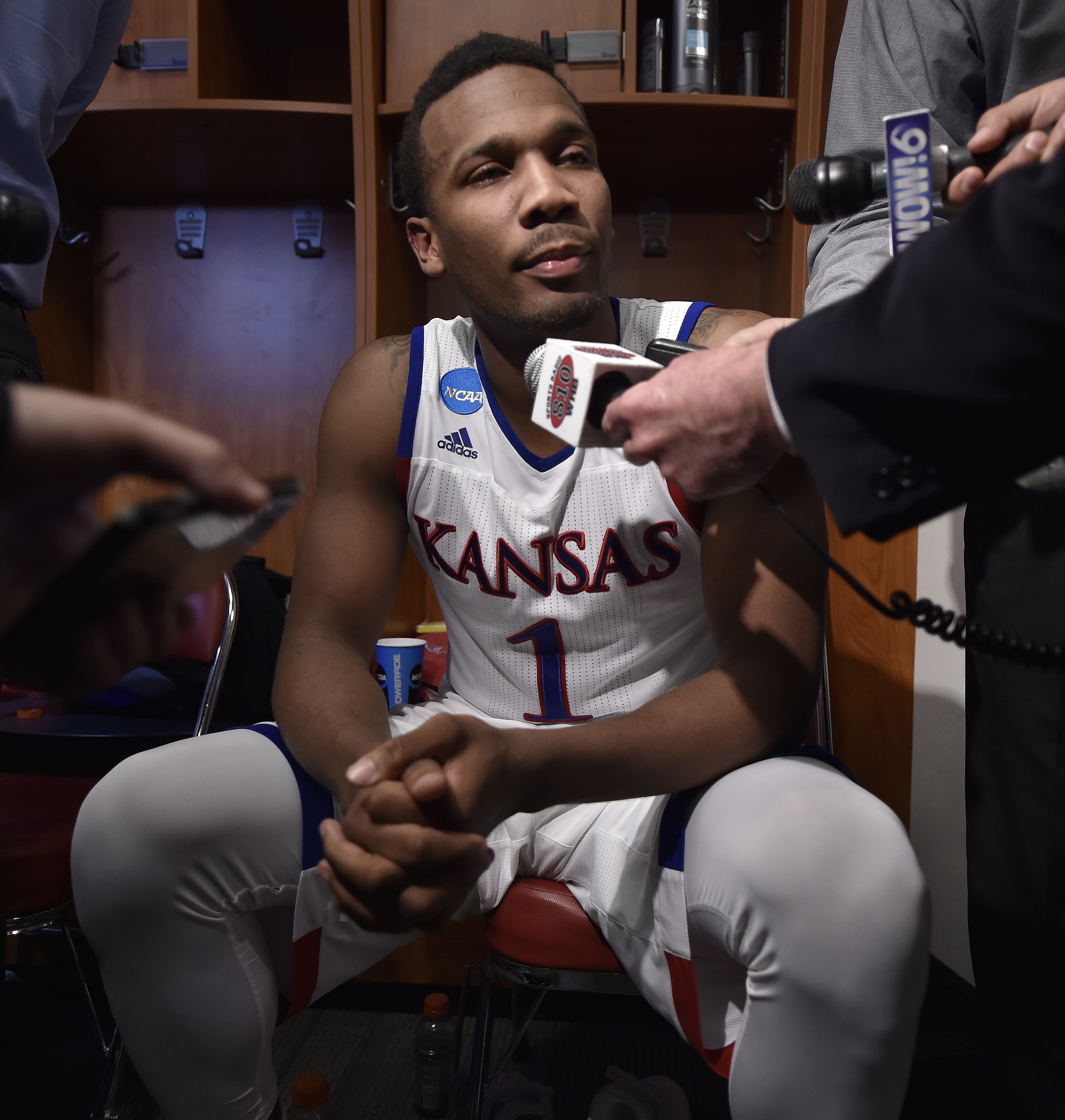 Kansas's Wayne Selden Jr., is interviewed in the locker room after a regional final men's college basketball game against Villanova in the NCAA Tournament, Saturday, March 26, 2016, in Louisville, Ky. Villanova won 64-59.(AP Photo/John Flavell)