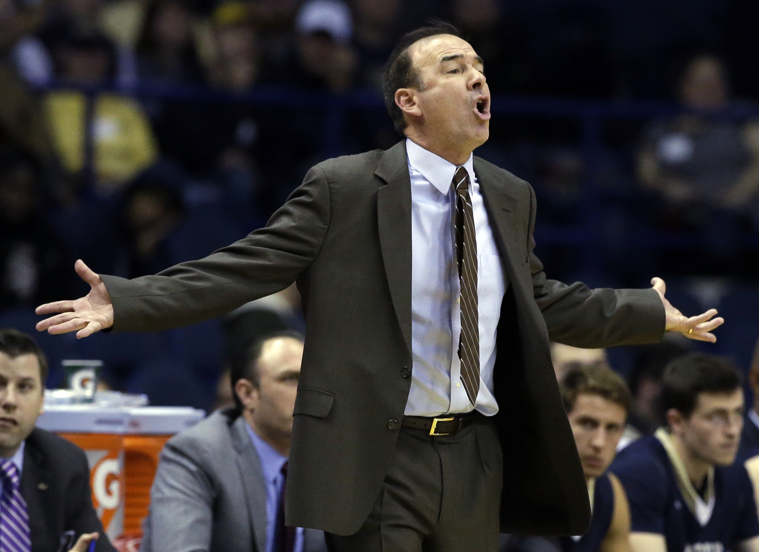 FILE - In this Dec. 22, 2015, file photo, George Washington head coach Mike Lonergan yells to his team during the first half of an NCAA college basketball game against DePaul in Rosemont, Ill. George Washington faces San Diego State, Tuesday, March 29, 20
