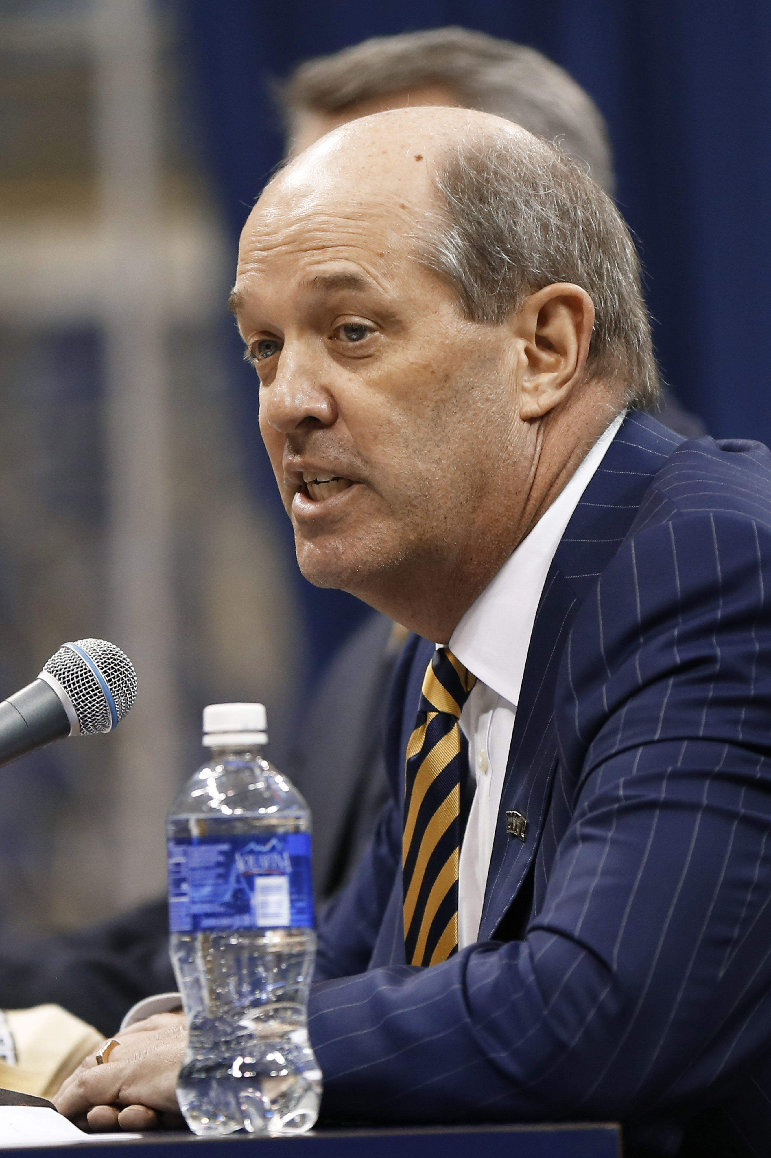 Kevin Stallings speaks at an introductory news conference as the new head coach for the Pittsburgh basketball team on Monday, March 28, 2016, in Pittsburgh. (AP Photo/Keith Srakocic)