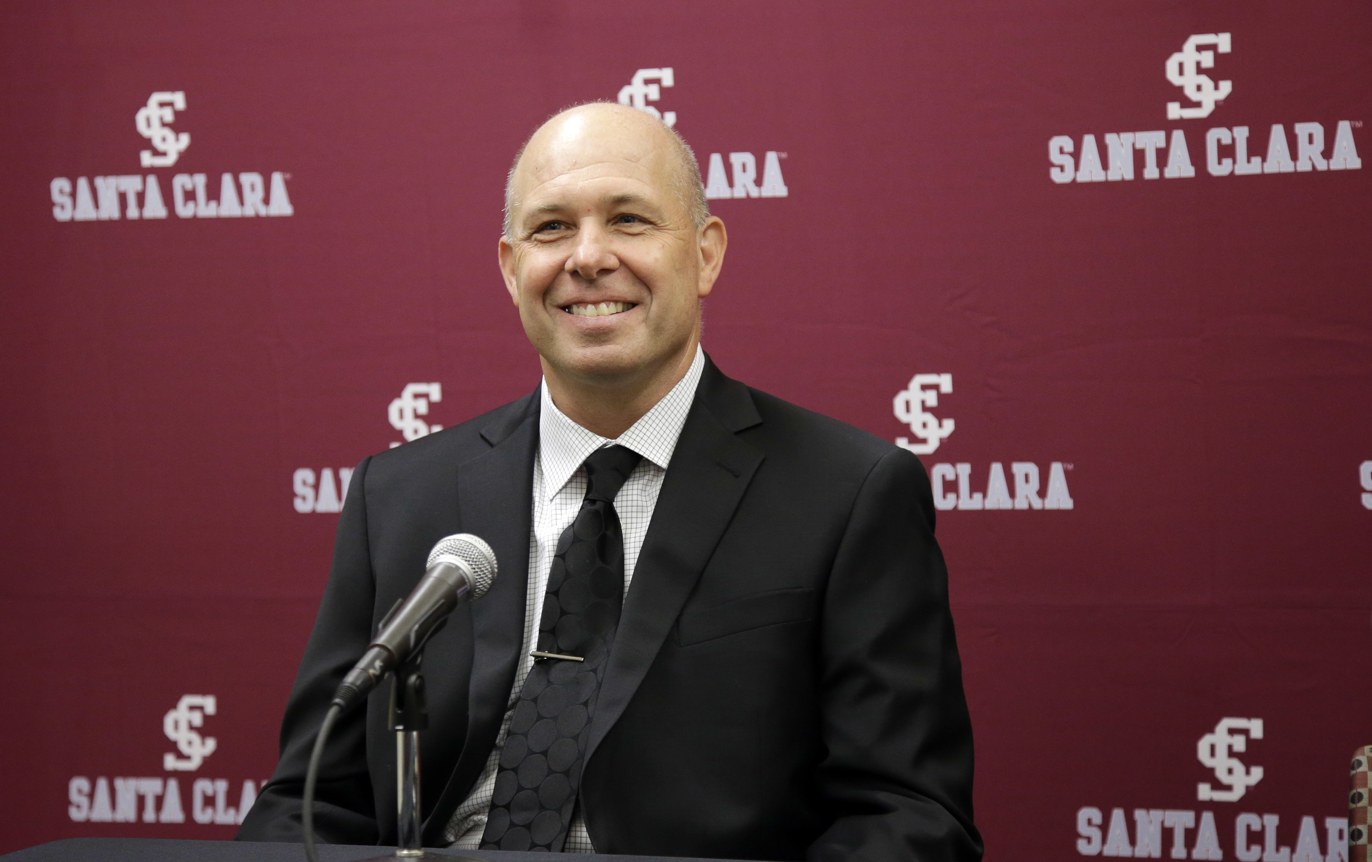 New Santa Clara men's NCAA college basketball coach Herb Sendek smiles as he is introduced at a news conference, Wednesday, March 30, 2016, in Santa Clara, Calif. (AP Photo/Marcio Jose Sanchez)