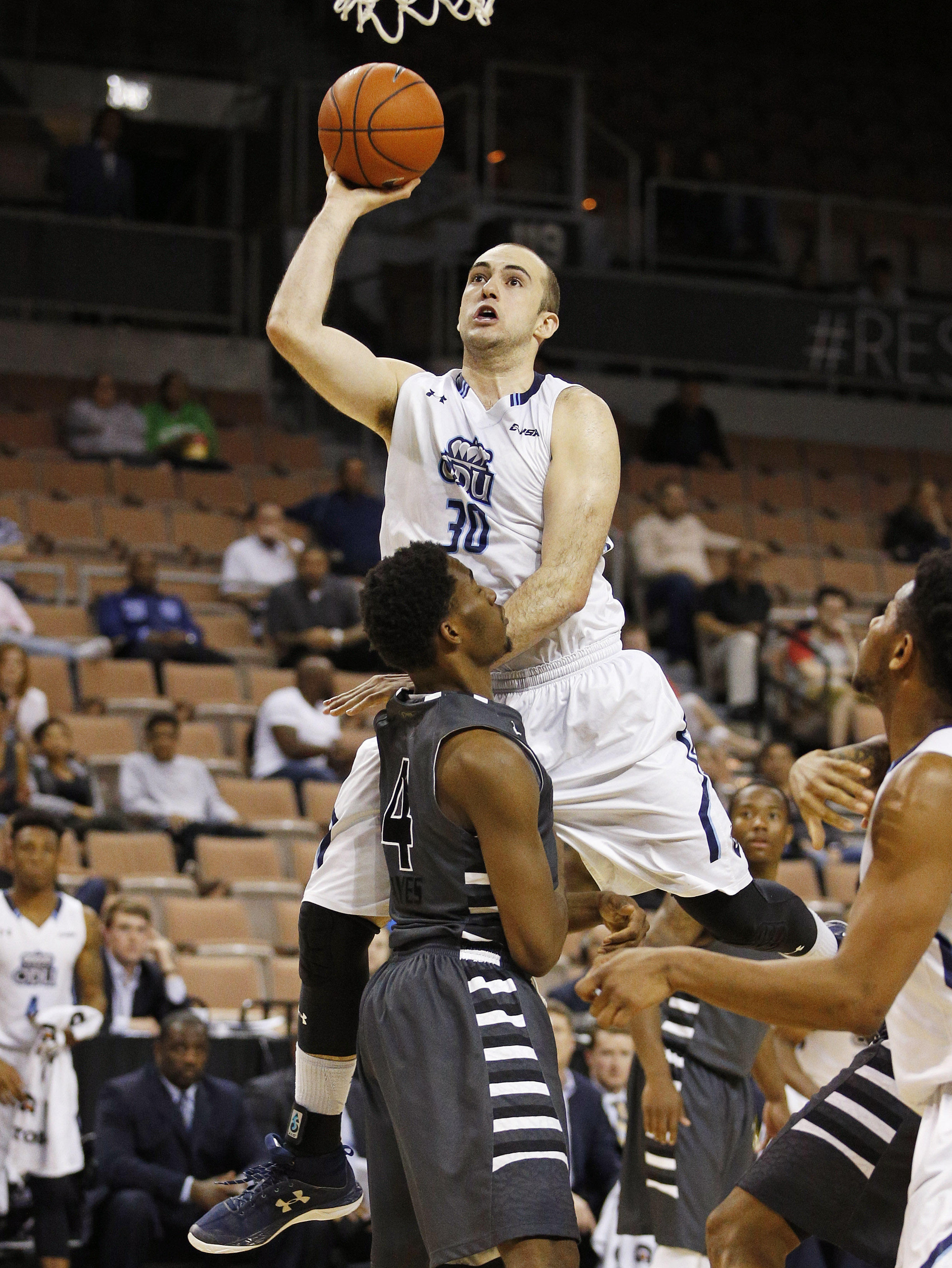 Old Dominion forward Nik Biberaj shoots over Oakland forward Jalen Hayes during the second half of an NCAA college basketball game for the Vegas 16 championship, Wednesday, March 30, 2016, in Las Vegas. Old Dominion won 68-67. (AP Photo/John Locher)