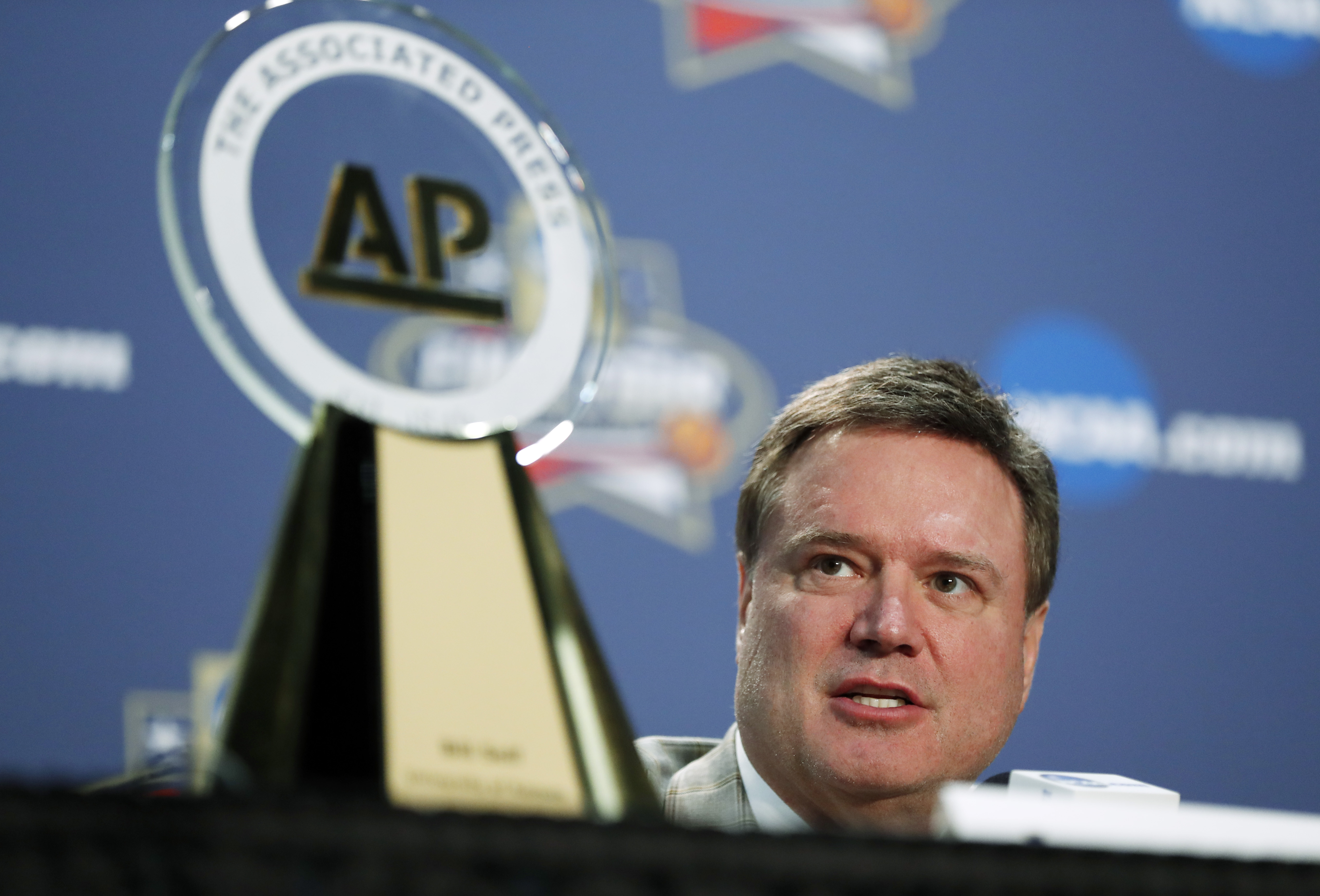 Kansas coach Bill Self answers a question near his Associated Press Coach of the Year trophy at a news conference at the NCAA Final Four college basketball tournament Thursday, March 31, 2016, in Houston. (AP Photo/David J. Phillip)
