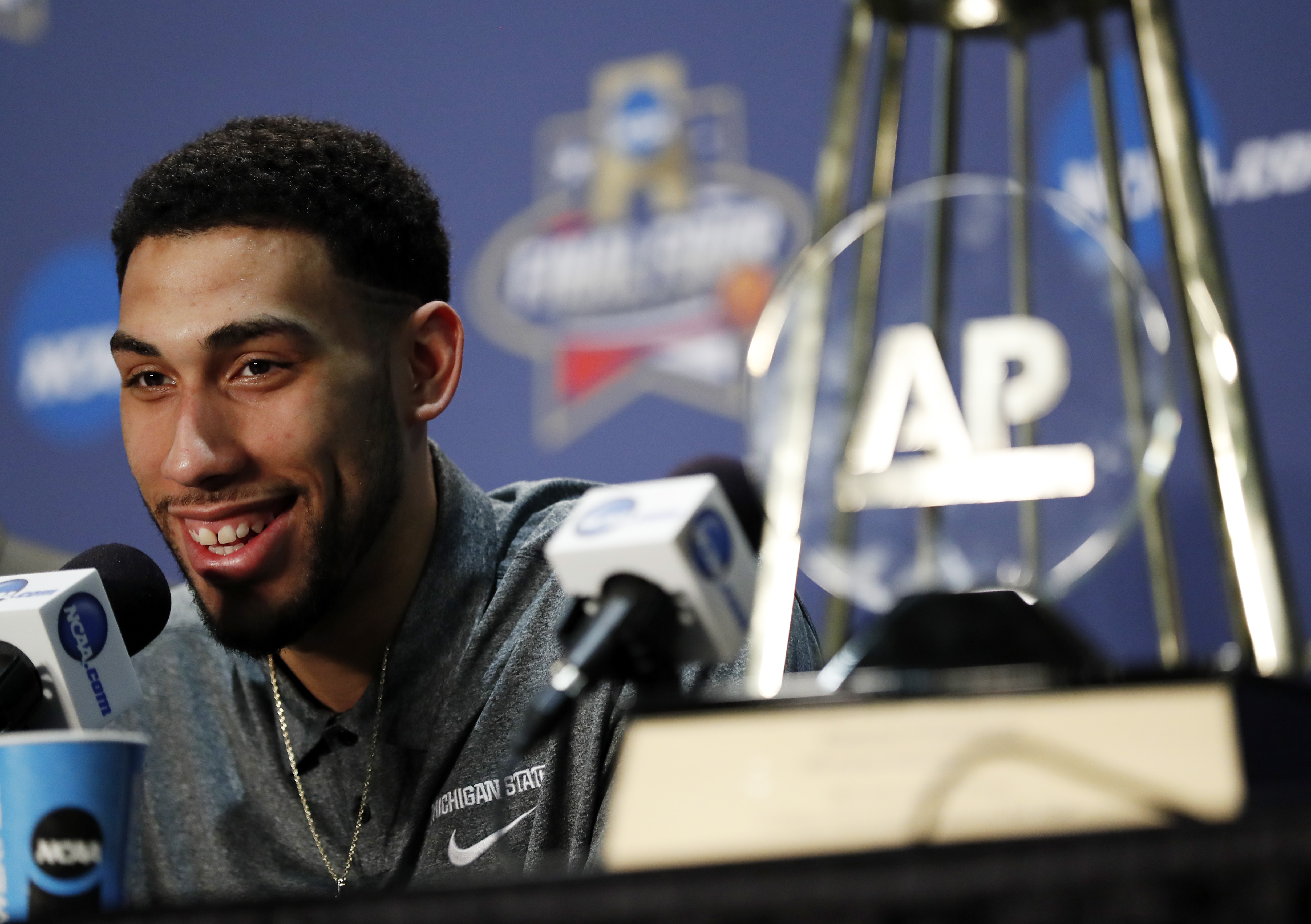 Michigan State's Denzel Valentine answers a questions with his Associated Press Player of the Year trophy at a news conference at the NCAA Final Four college basketball tournament Thursday, March 31, 2016, in Houston. (AP Photo/David J. Phillip)