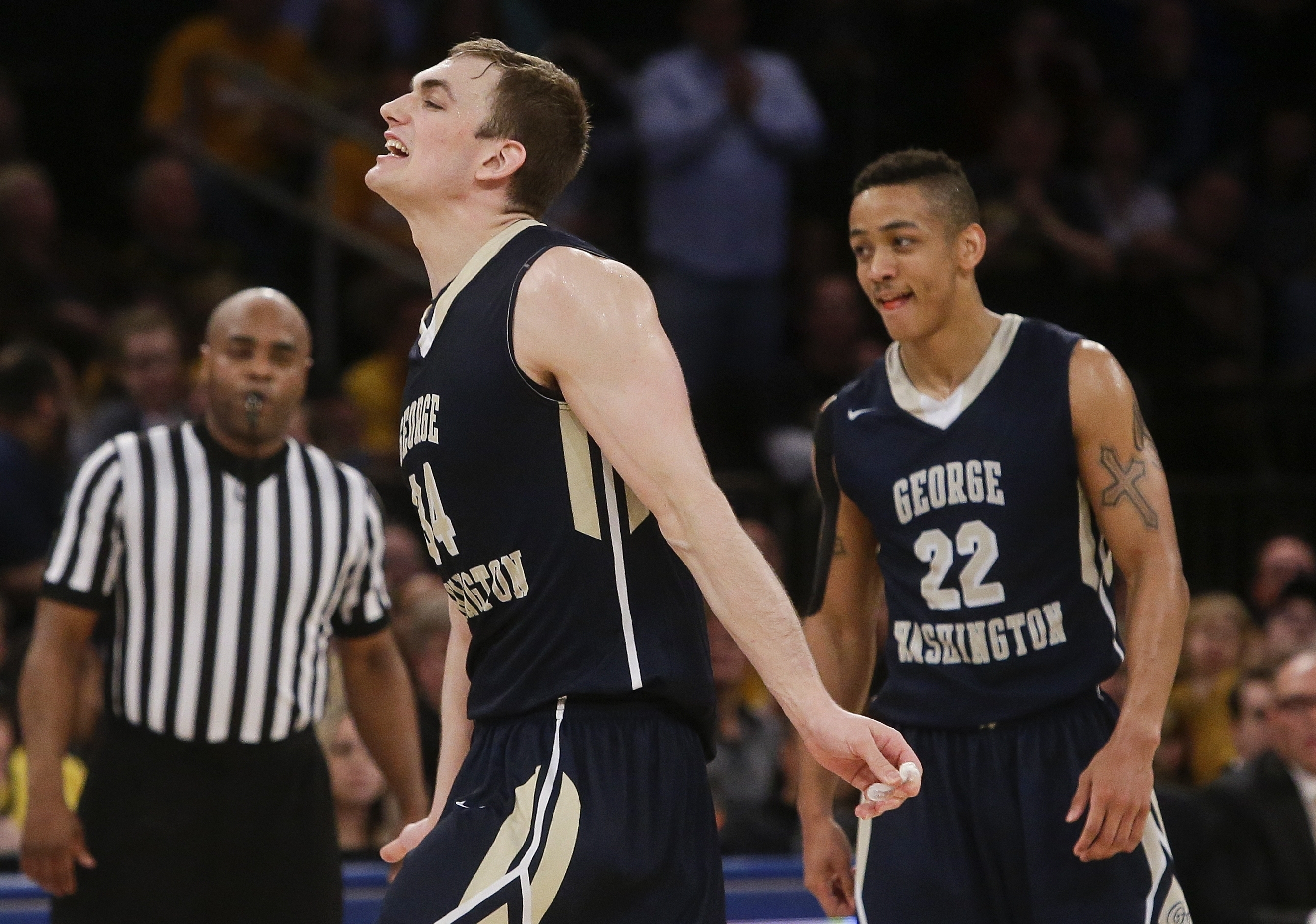 George Washington's Tyler Cavanaugh (34) and Joe McDonald (22) celebrate during the second half of an NCAA college basketball game against Valparaiso in the final of the NIT on Thursday, March 31, 2016, in New York. George Washington won 76-60. (AP Photo/