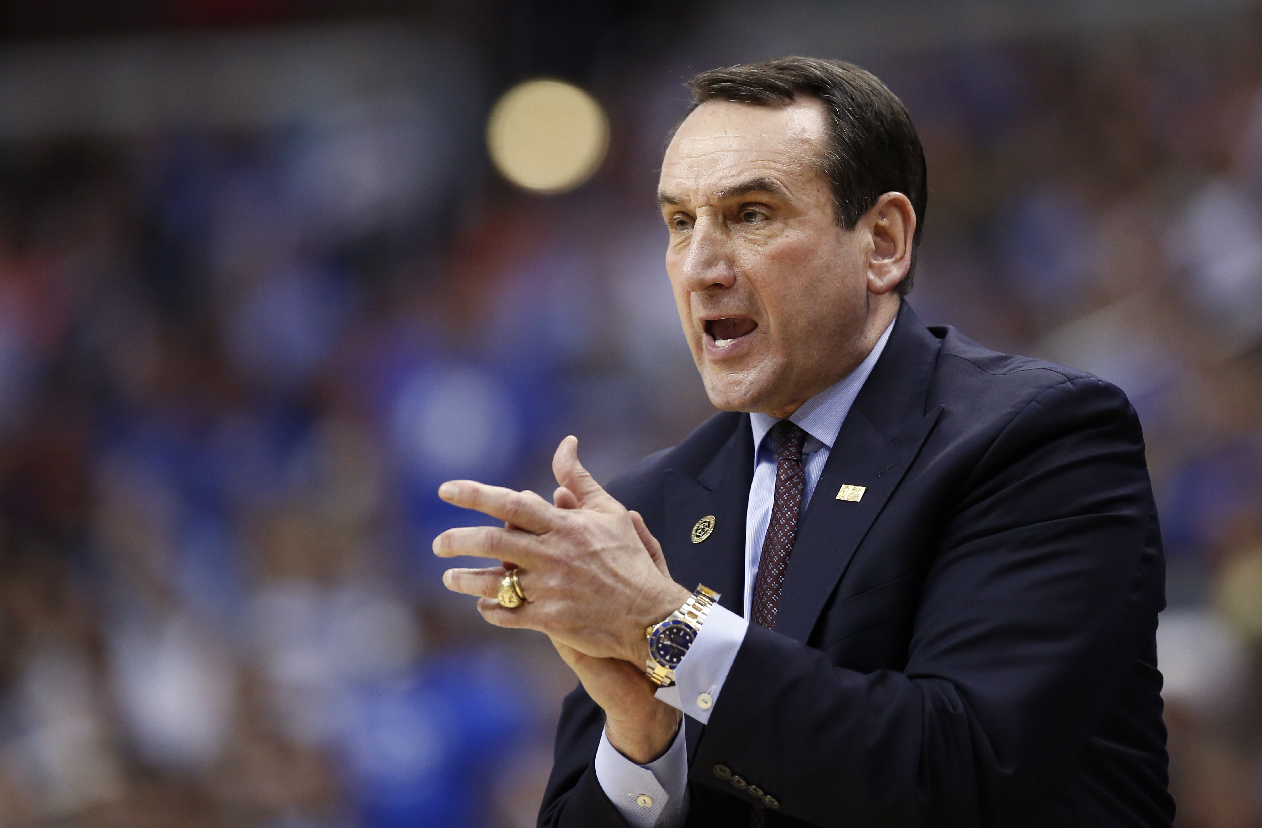FILE - In this Thursday, March 10, 2016 file photo, Duke head coach Mike Krzyzewski reacts during the first half of an NCAA college basketball game in the Atlantic Coast Conference tournament against Notre Dame in Washington. Oregon coach Dana Altman's me