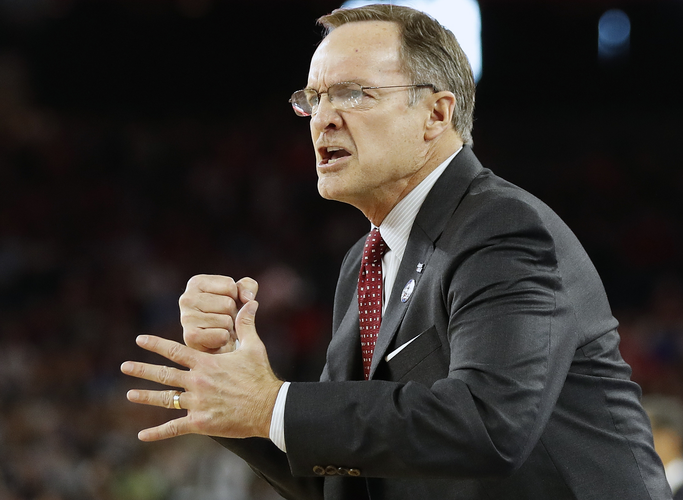 Oklahoma head coach Lon Kruger watches play against Villanova during the first half of the NCAA Final Four tournament college basketball semifinal game Saturday, April 2, 2016, in Houston. (AP Photo/Eric Gay)
