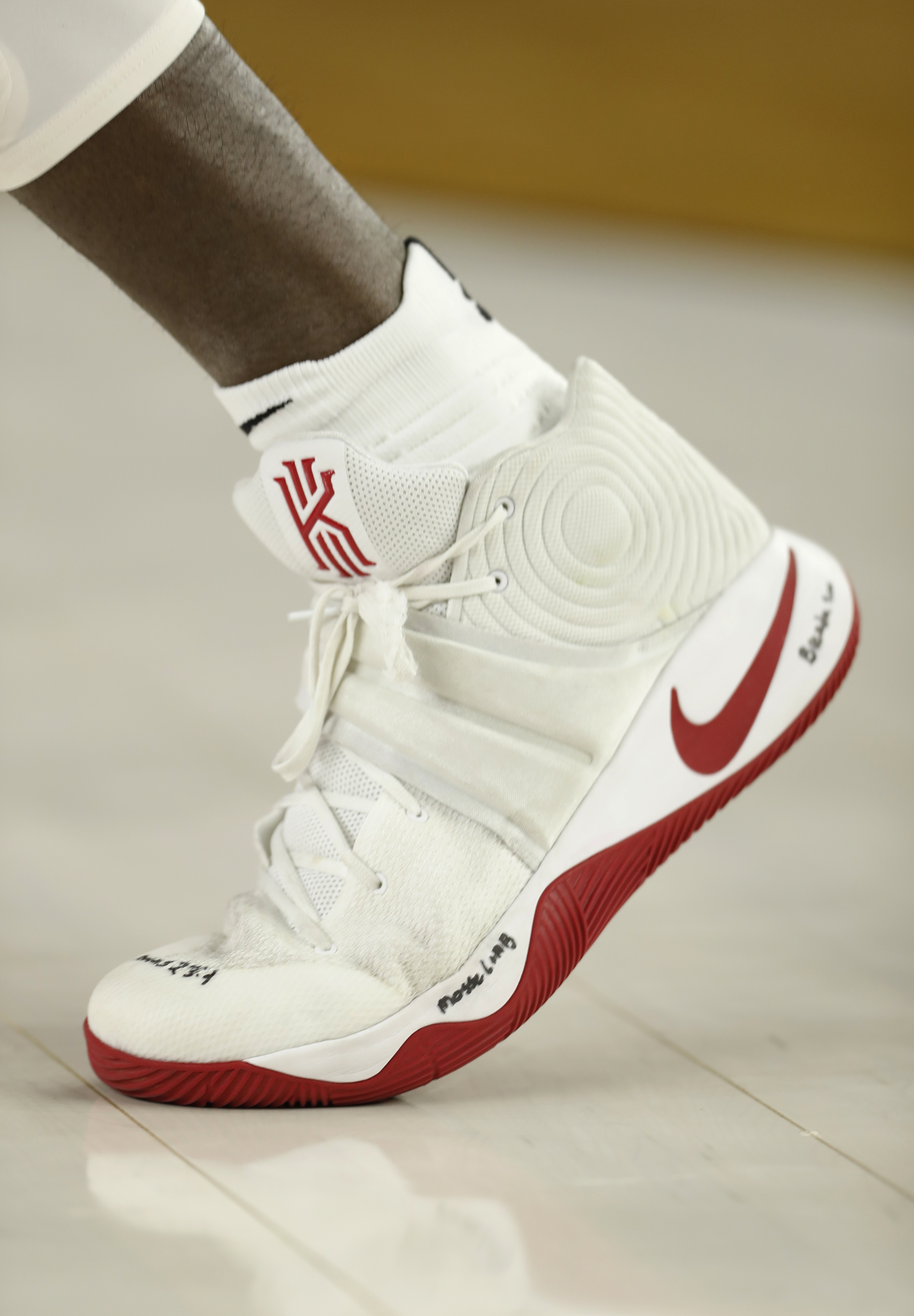 Oklahoma's Khadeem Lattin wears writing on his shoes as a tribute to his grandmother who died this weeks during the first half of the NCAA Final Four tournament college basketball semifinal game against Villanova, Saturday, April 2, 2016, in Houston. (AP