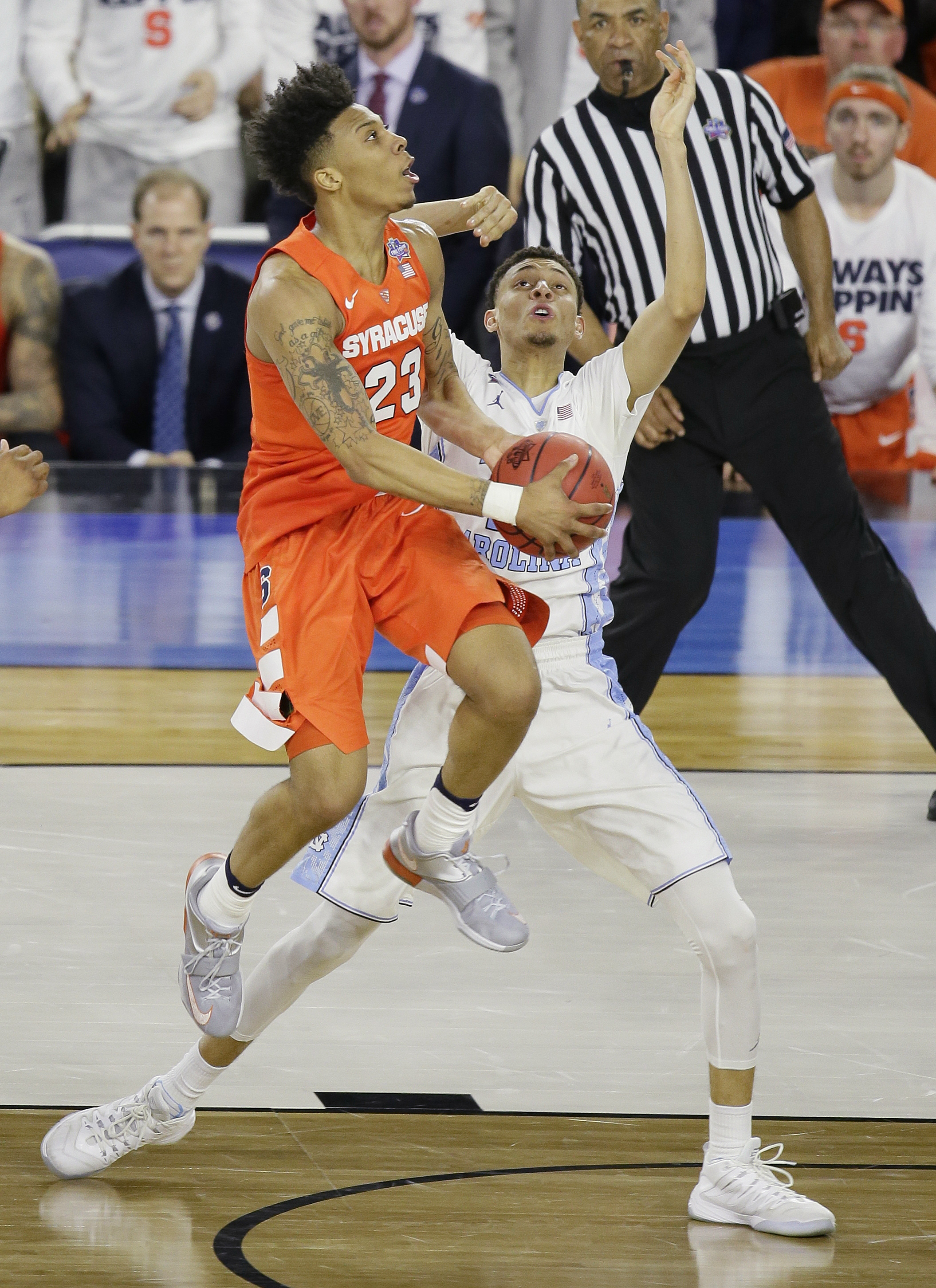 North Carolina forward Justin Jackson (44) works against Syracuse guard Malachi Richardson (23)  during the second half of the NCAA Final Four tournament college basketball semifinal game Saturday, April 2, 2016, in Houston. (AP Photo/Charlie Neibergall)