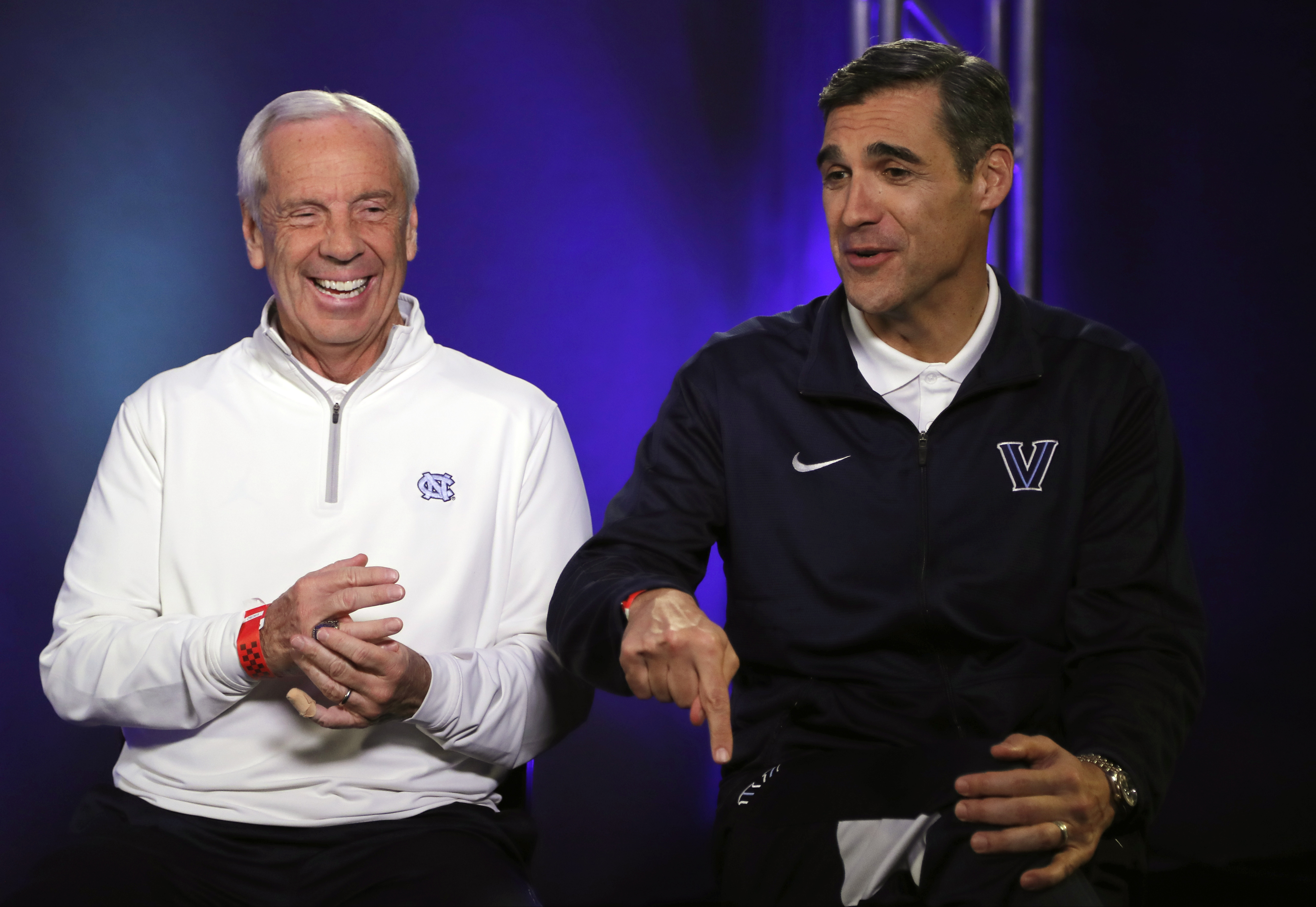 North Carolina head coach Roy Williams and Villanova head coach Jay Wright laugh during a CBS Sports Network interview for the NCAA Final Four tournament college basketball championship game Sunday, April 3, 2016, in Houston. Villanova and North Carolina