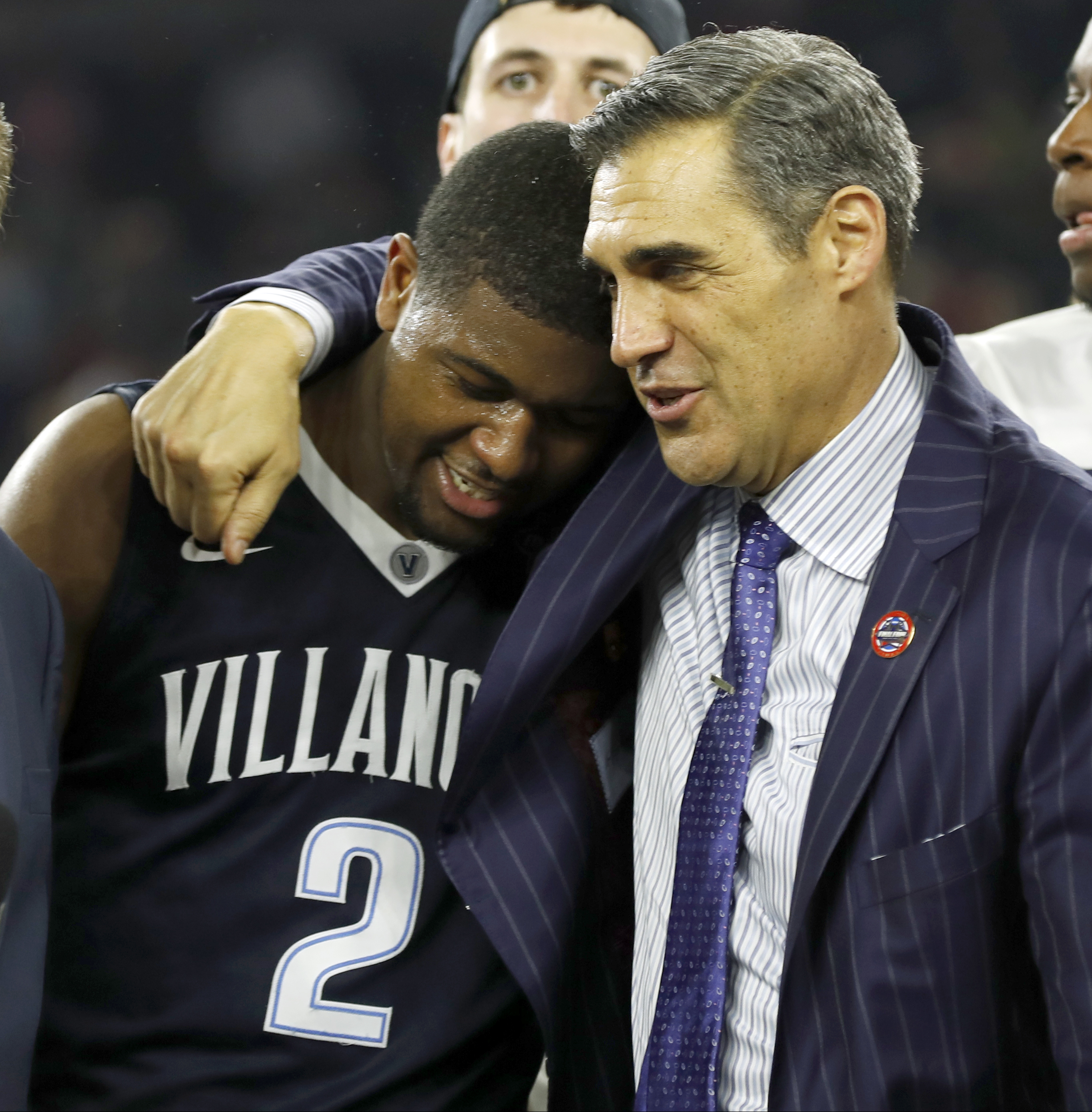Villanova head coach Jay Wright, right, embraces Kris Jenkins after Jenkins scored a game winning three point basket in the closing seconds of the NCAA Final Four tournament college basketball championship game against North Carolina, Monday, April 4, 201