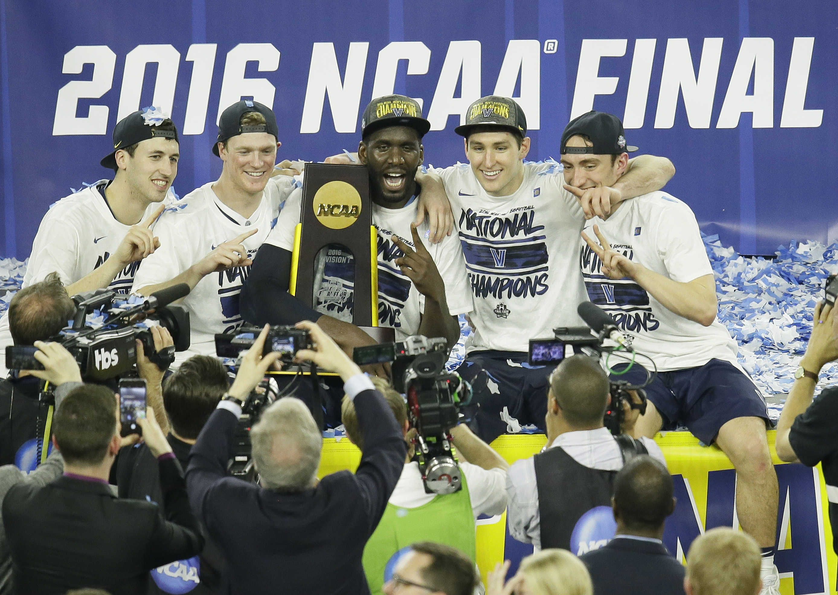 Villanova players celebrate after the NCAA Final Four tournament college basketball championship game against North Carolina, Monday, April 4, 2016, in Houston. Villanova won 77-74. (AP Photo/Charlie Neibergall)
