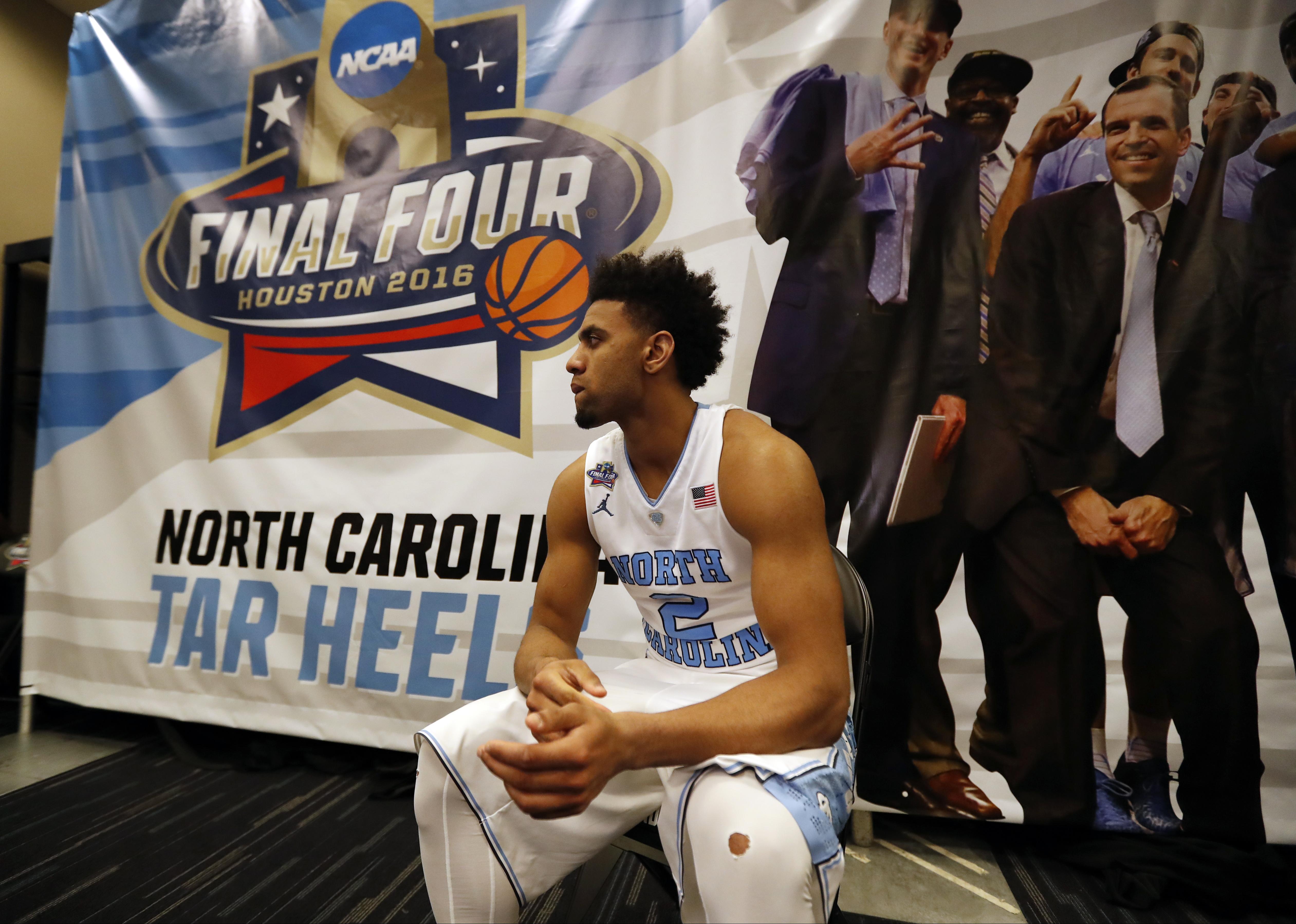 North Carolina's Joel Berry II sits after the NCAA Final Four tournament college basketball championship game against Villanova, Monday, April 4, 2016, in Houston. Villanova won 77-74. (AP Photo/Eric Gay)