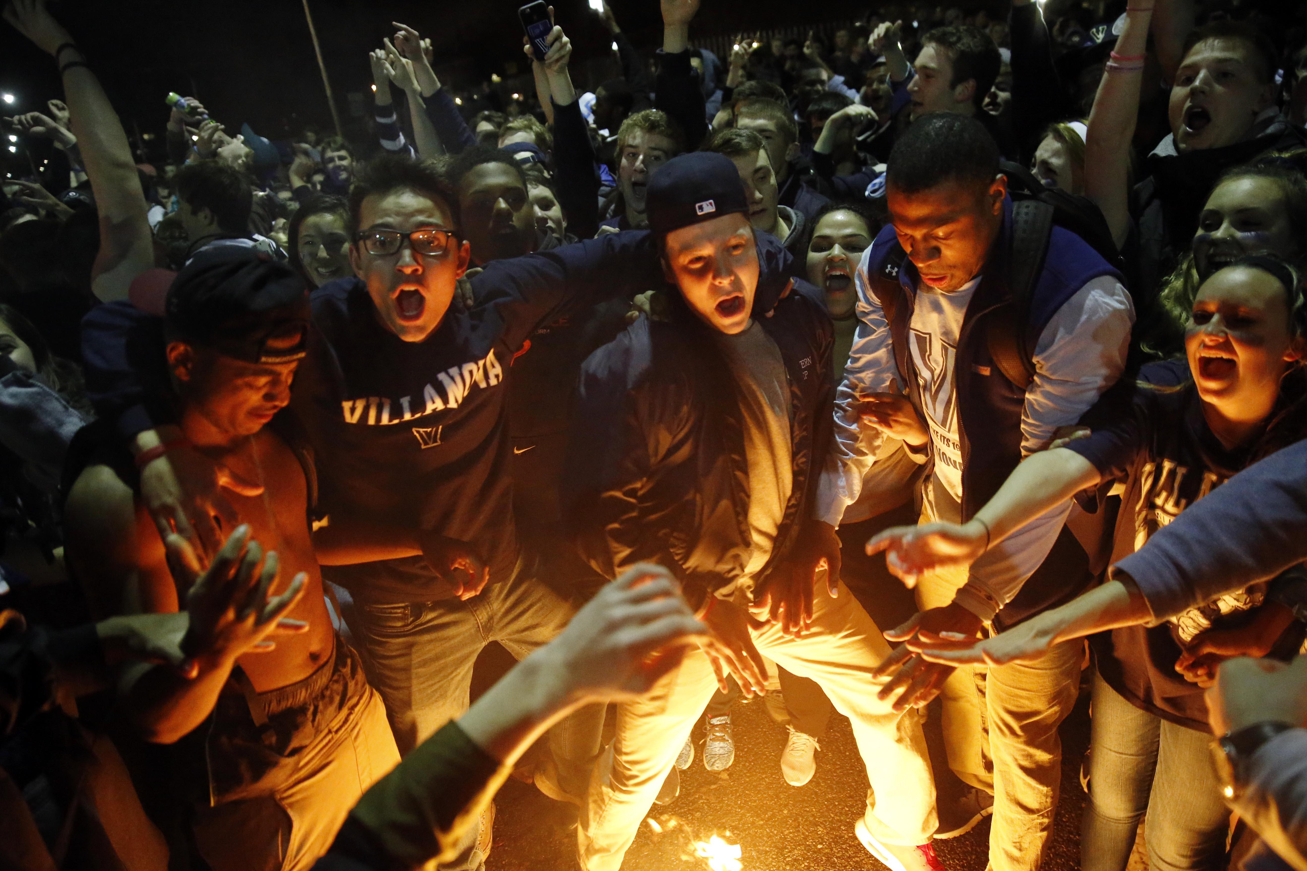 Villanova basketball fans celebrate after Villanova defeated North Carolina in the college basketball championship game of the NCAA Tournament, Tuesday, April 5, 2016, in Villanova, Pa. Villanova won 77-74. (AP Photo/Matt Rourke)